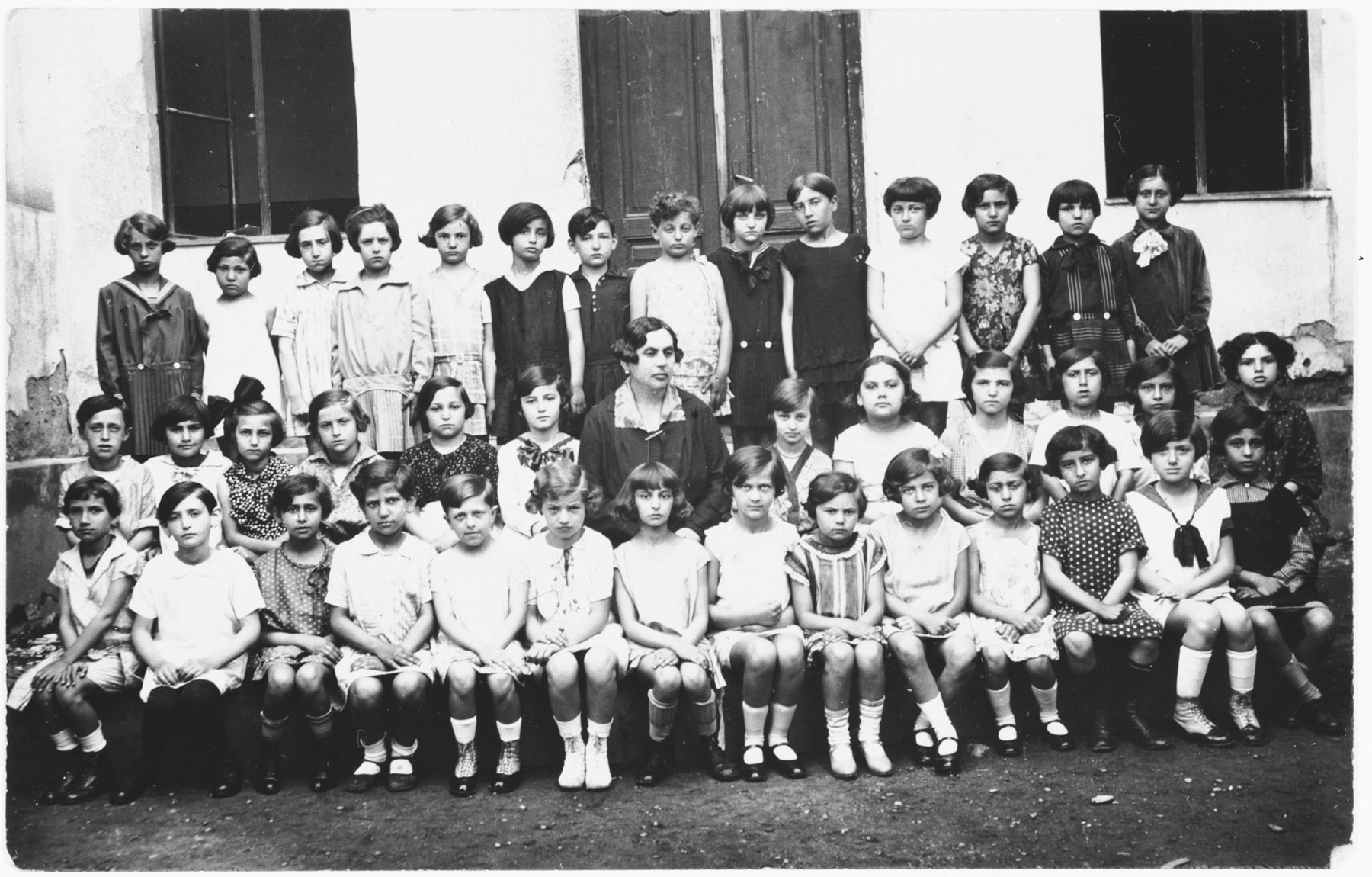 Girls in a school in Oradea, Romania.  Magda Grunfeld is pictured in the front row, center.