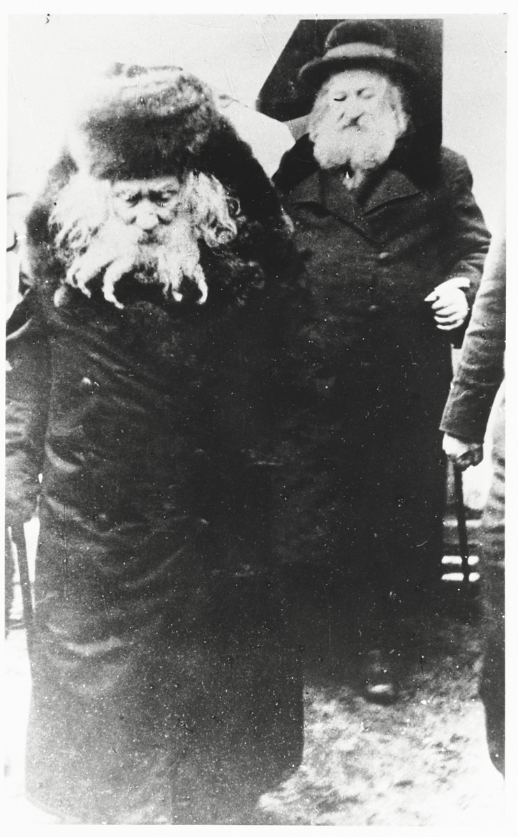 The Gerer Rebbe, Rabbi Abraham Mordecai Alter and, walks down a street accompanied by his brother Rabbi Moshe Betzelal.