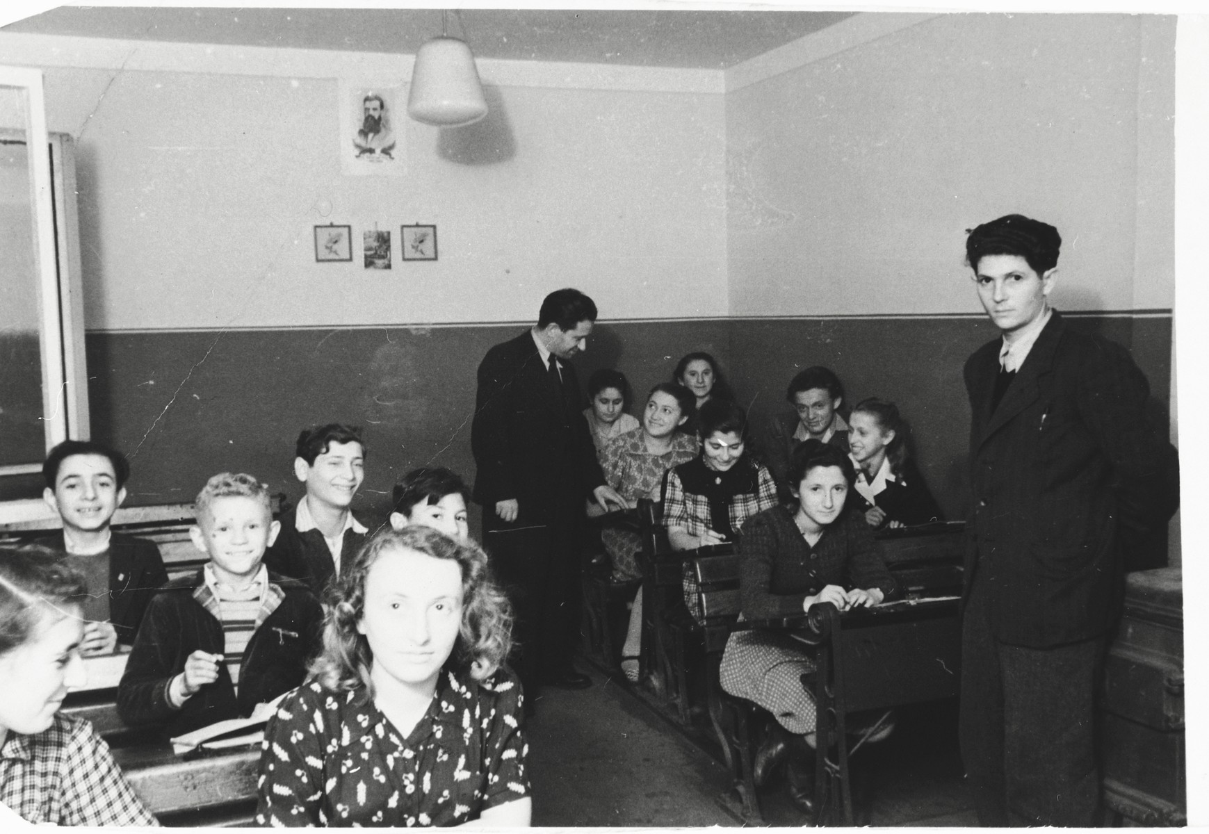 Children studying in a classroom in the Zeilsheim children's center.  Szlomo Waks is pictured in the second row, on the left.