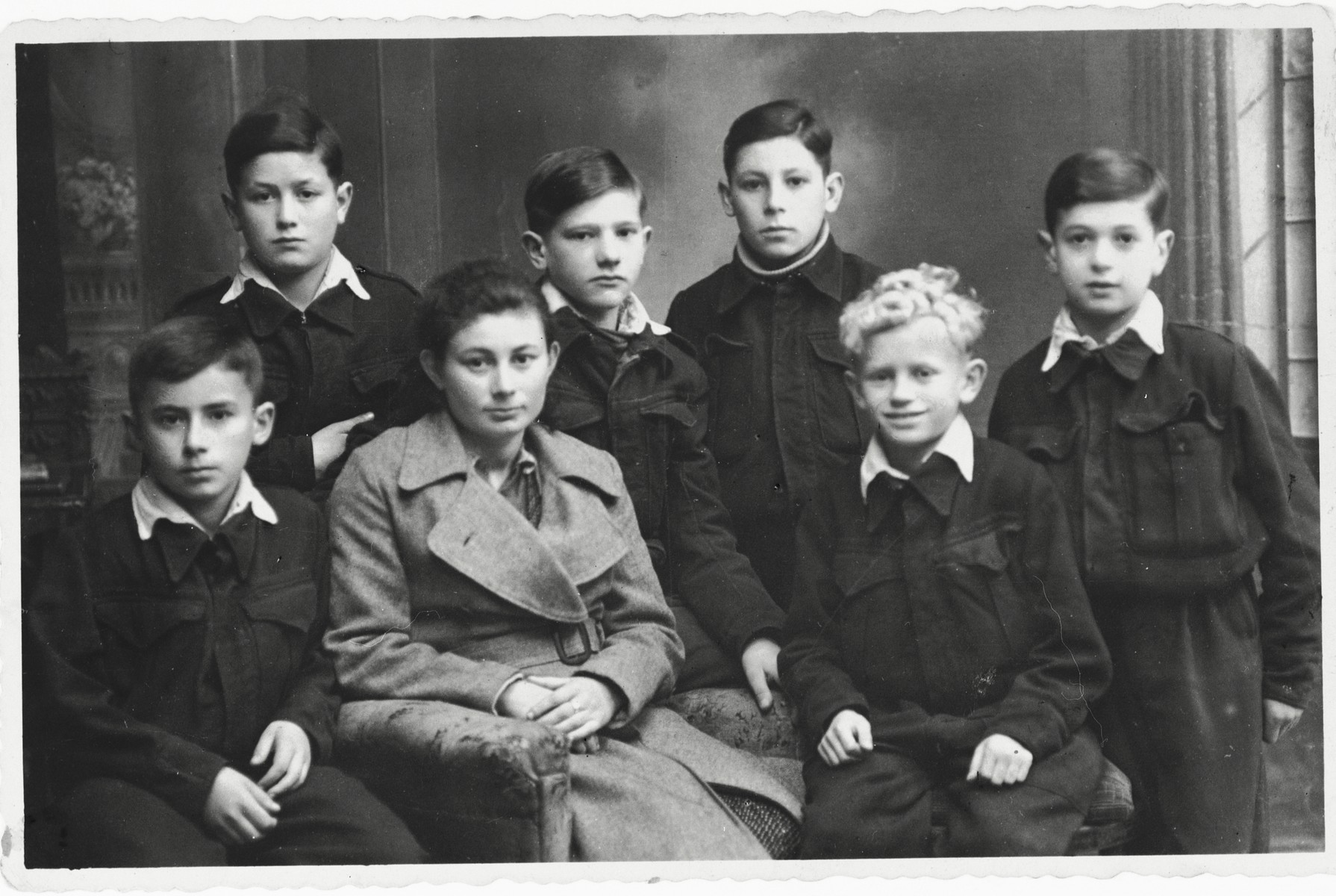 Children in a Jewish orphanage in Peterswaldau.  Szlomo Waks is seated in the front right.