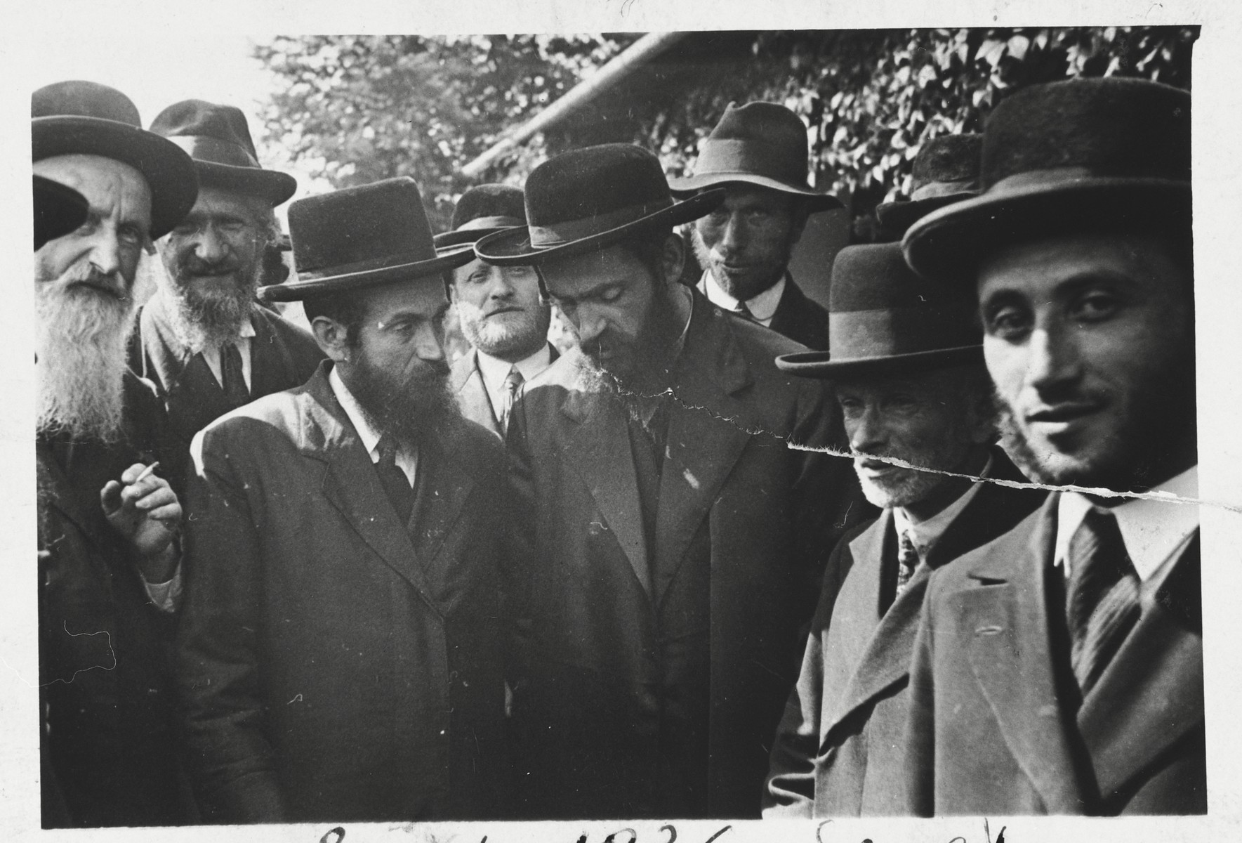 A group of religious Jewish men at a gathering in Sanok.