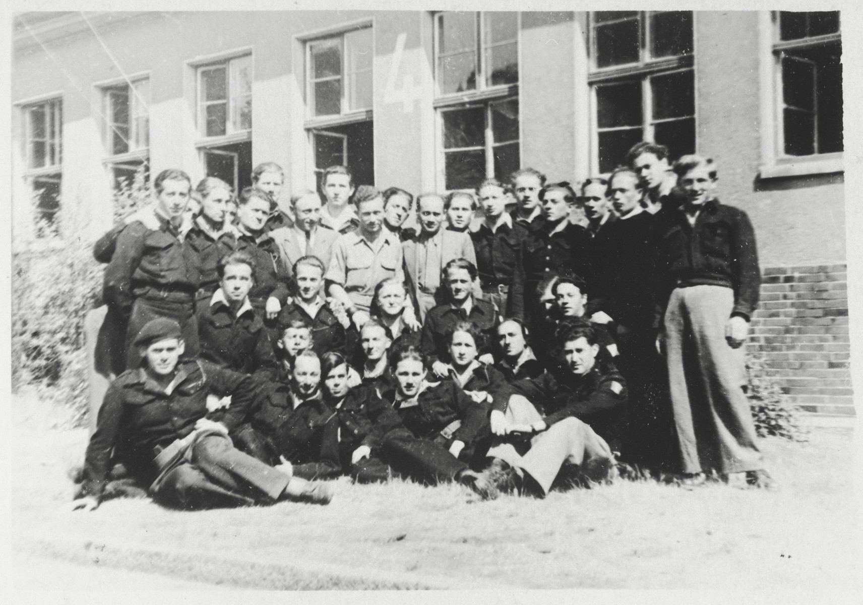 Group portrait of a Jewish police force in the Bergen-Belsen displaced persons camp.  Meyer Strossberg is pictured in the center of the photo.
