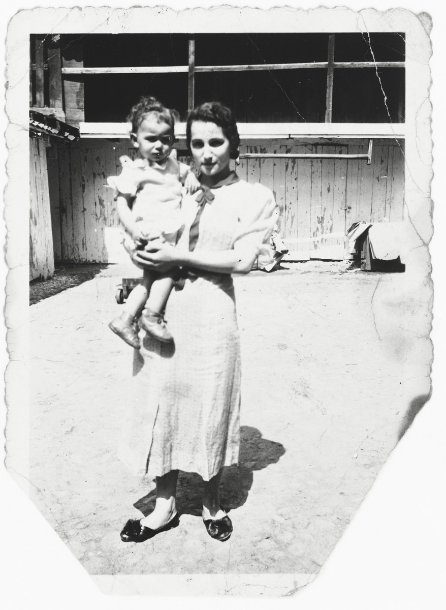 Rosa Magid holds her baby daughter, Bertha, in her arms.