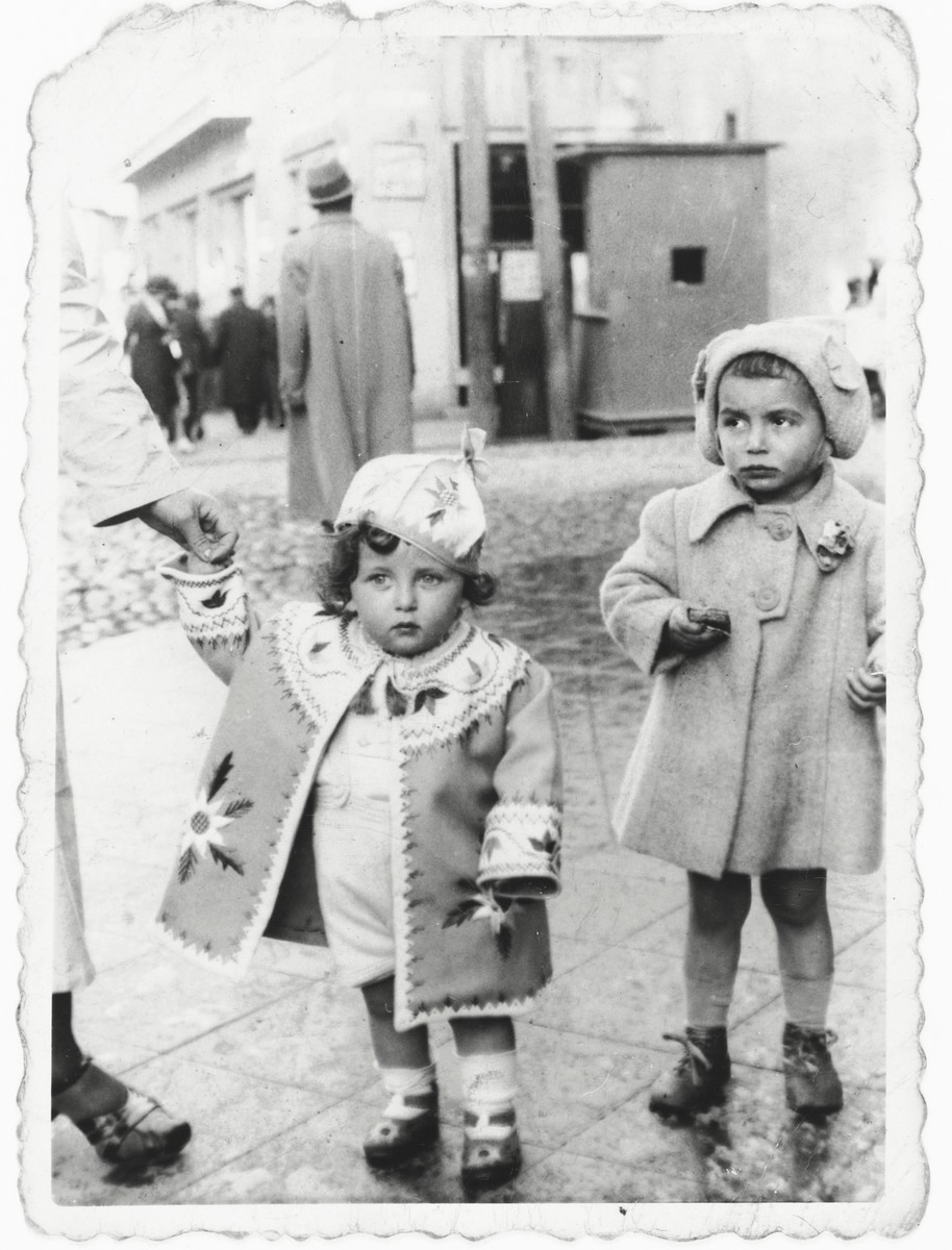 Bertha Magid and her cousin stand on a street corner in Bialystok.