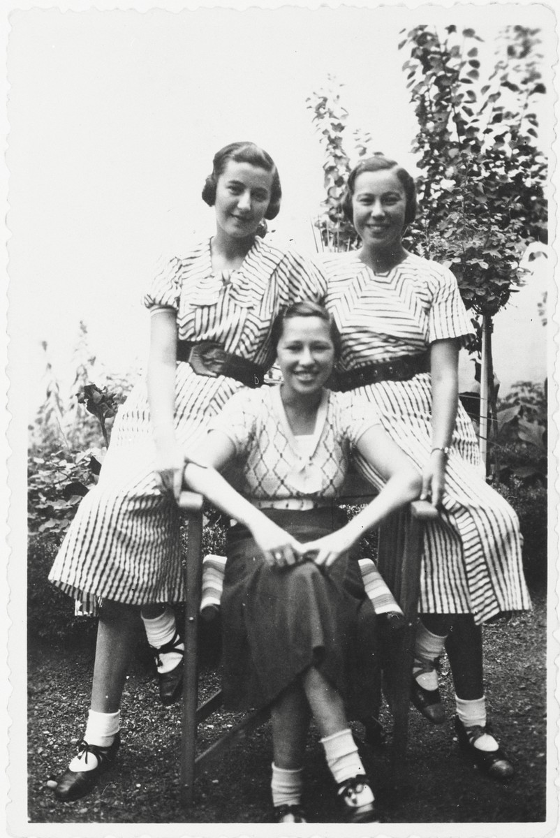 Magda Grunfeld poses in a garden with her two cousins.  From left to right are Magda Grunfeld, Edit Rodan and Edit's sister.