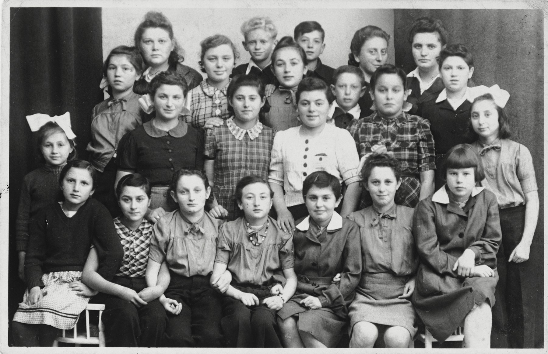 Children in a Jewish orphanage in Peterswaldau.  Szlomo Waks is standing in the center of the back row.