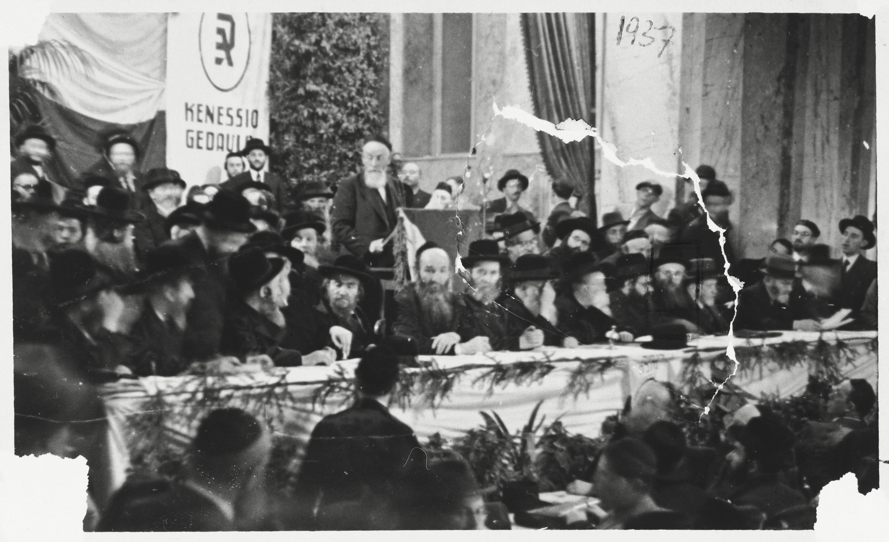Religious Jews gather for an Agudat Yisrael convention in Marienbad.  Rabbi Yaakov Rosenheim from Germany is speaking.