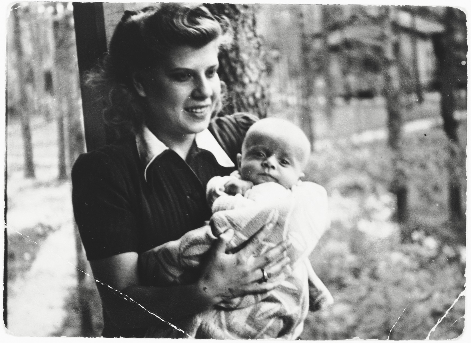 Nina Szapszewicz Ginter holds her infant son, Bogdan, while posing as a Polish woman in Warsaw.