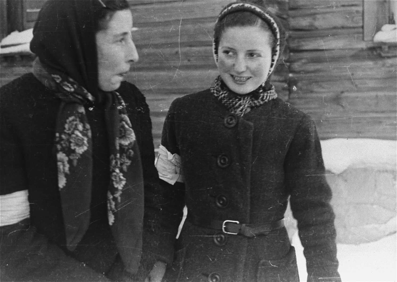 Local Jewish women wearing armbands pose for a photo taken by Jewish conscripts in the Hungarian Labor Service.