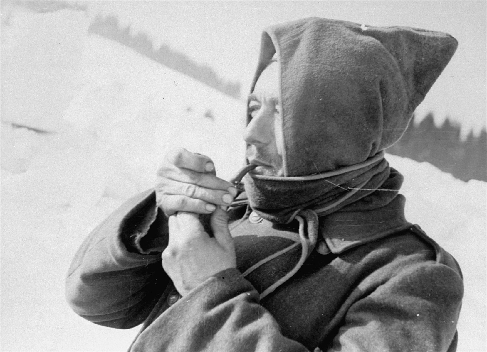 A Jewish conscript in Company 108/57 of the Hungarian Labor Service smoking during a break from work.