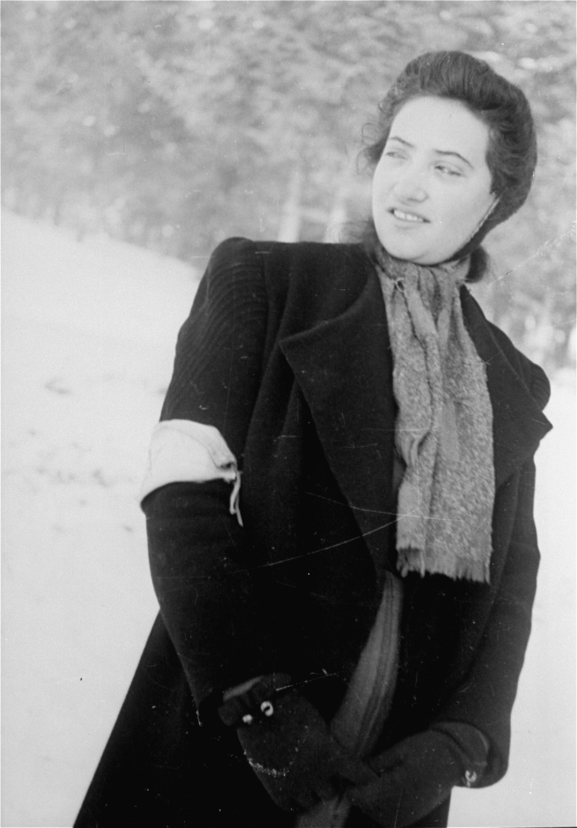 A local Jewish woman, wearing an armband, poses for a photo taken by Jewish conscripts in the Hungarian Labor Service.