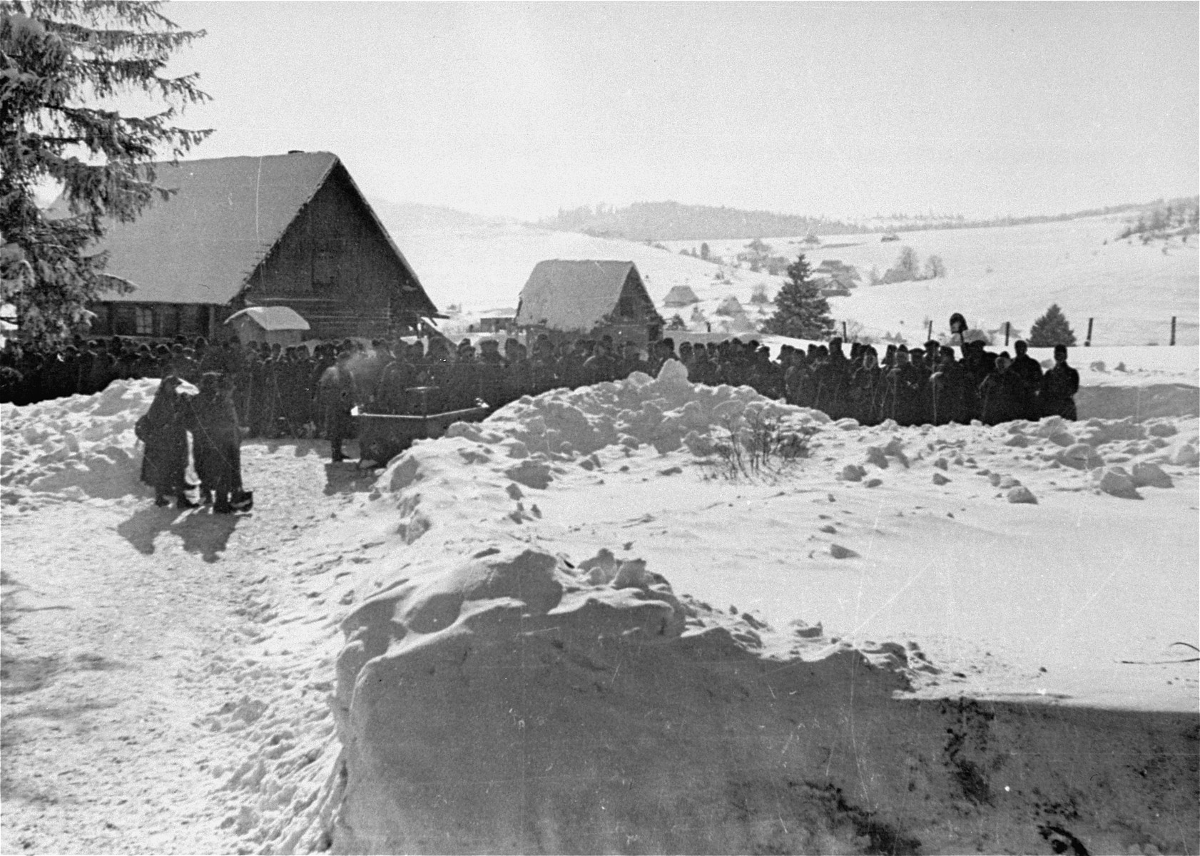 Jewish conscripts in Company 108/57 of the Hungarian Labor Service assembled for work clearing snow from roads.