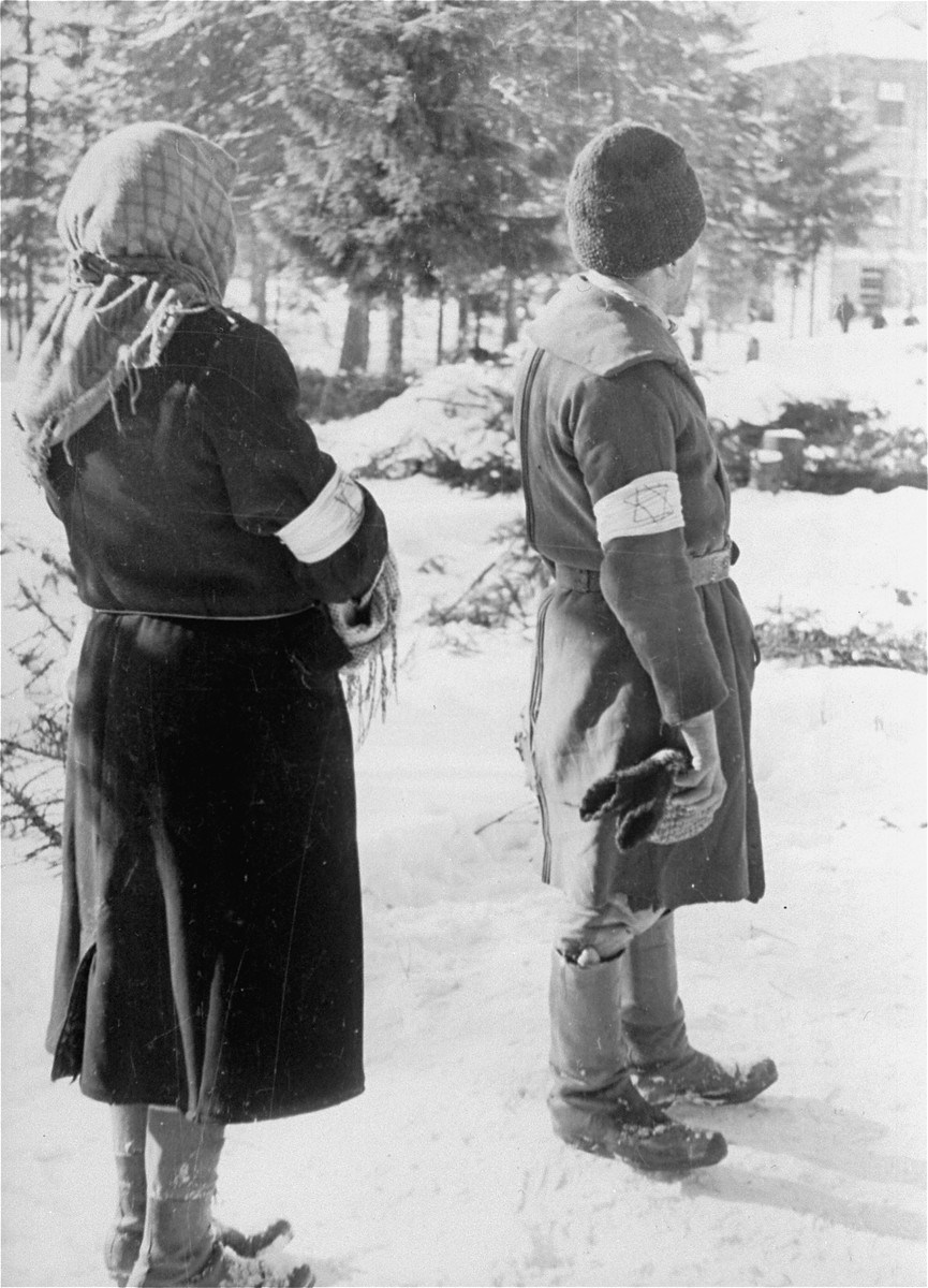 A Jewish couple wearing armbands stands near the Hungarian-Jewish Labor Camp where Company 108/57 was housed.