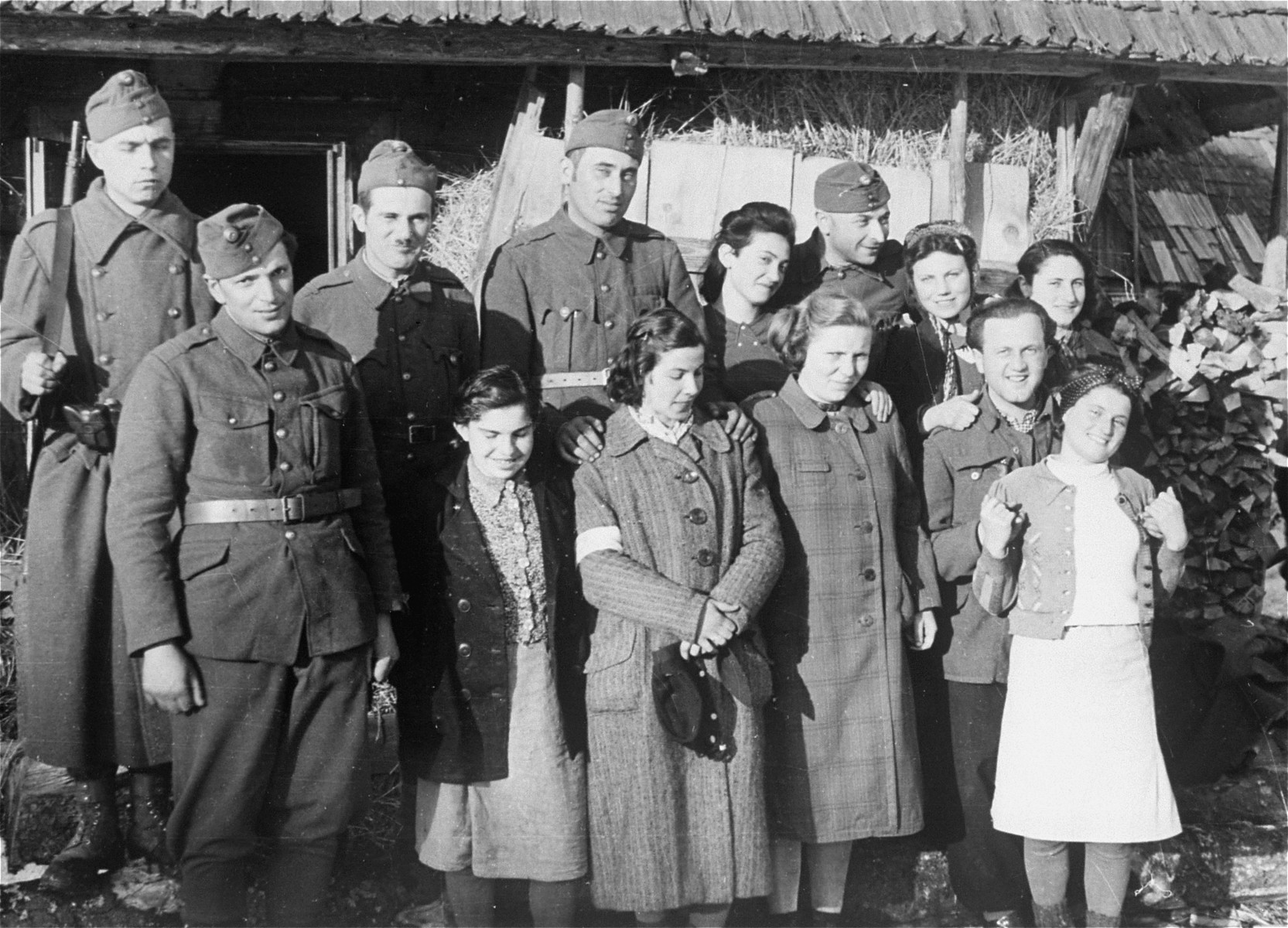 Local Jewish women wearing armbands pose with Dr. Adalbert Feher near the Hungarian-Jewish Labor Camp where Company 108/57 was housed.