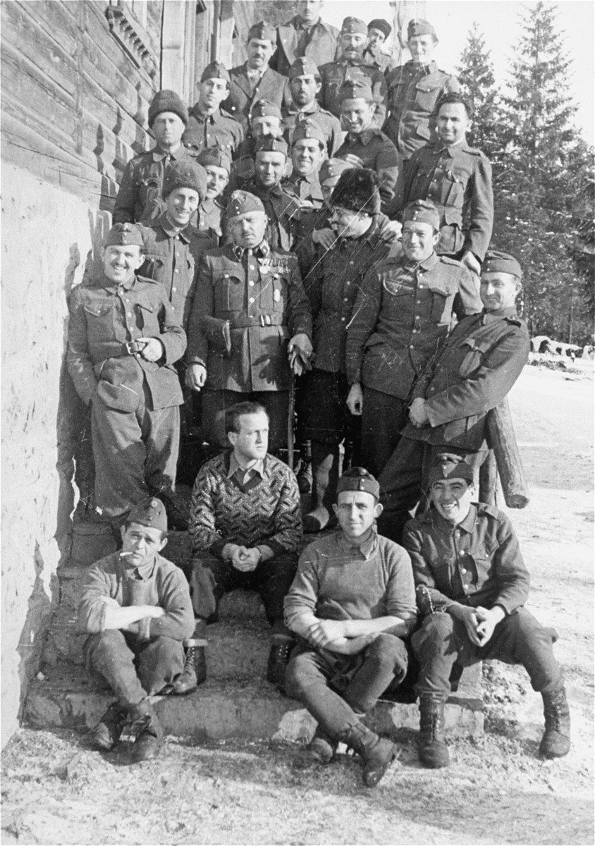 Hungarian-Jewish conscripts in Company 108/57 of the Hungarian Labor Service, after their return to Ungvar from Sianki. Their sergeant stands in the middle.