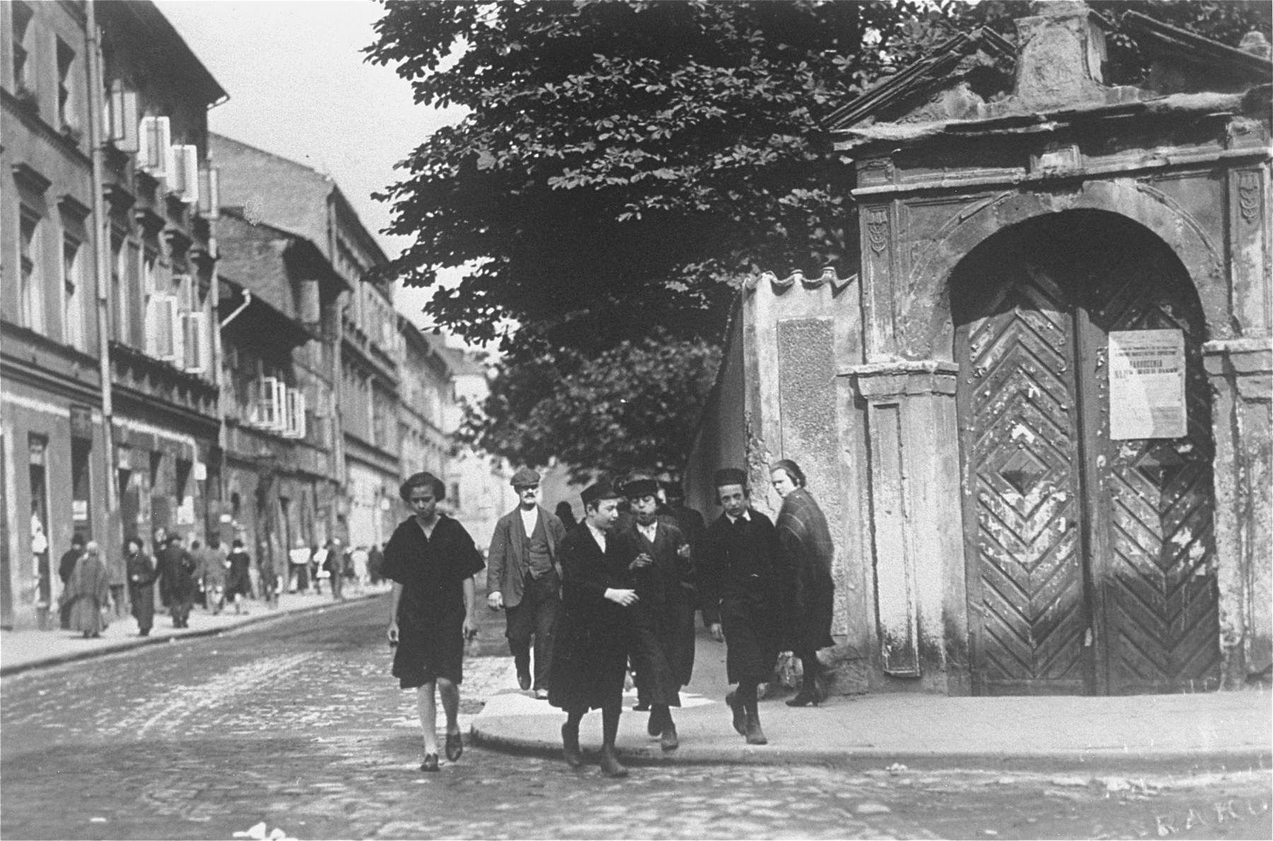 A group of Jewish children cross a street in Kazimierz, the Jewish quarter of Krakow.