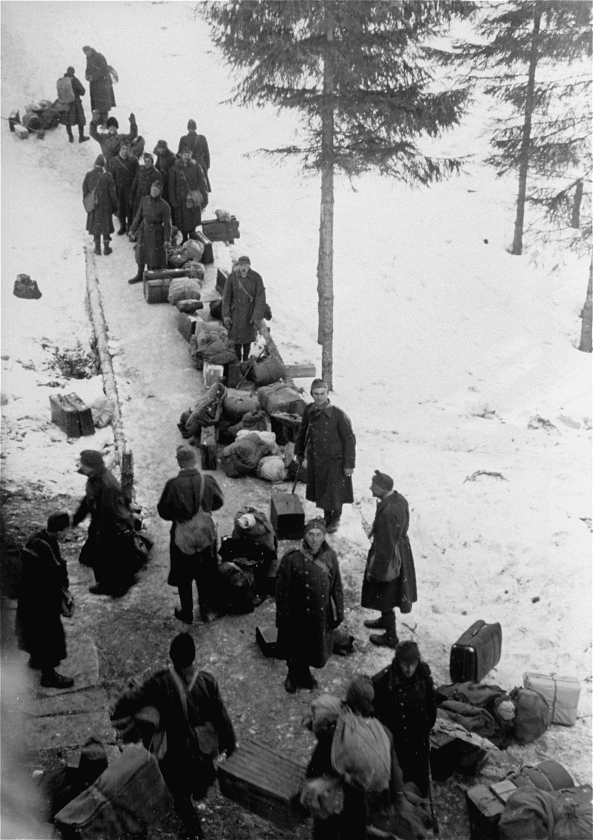 Hungarian-Jewish conscripts in the Hungarian Labor Service prepare for their journey back to Ungvar, Hungary.