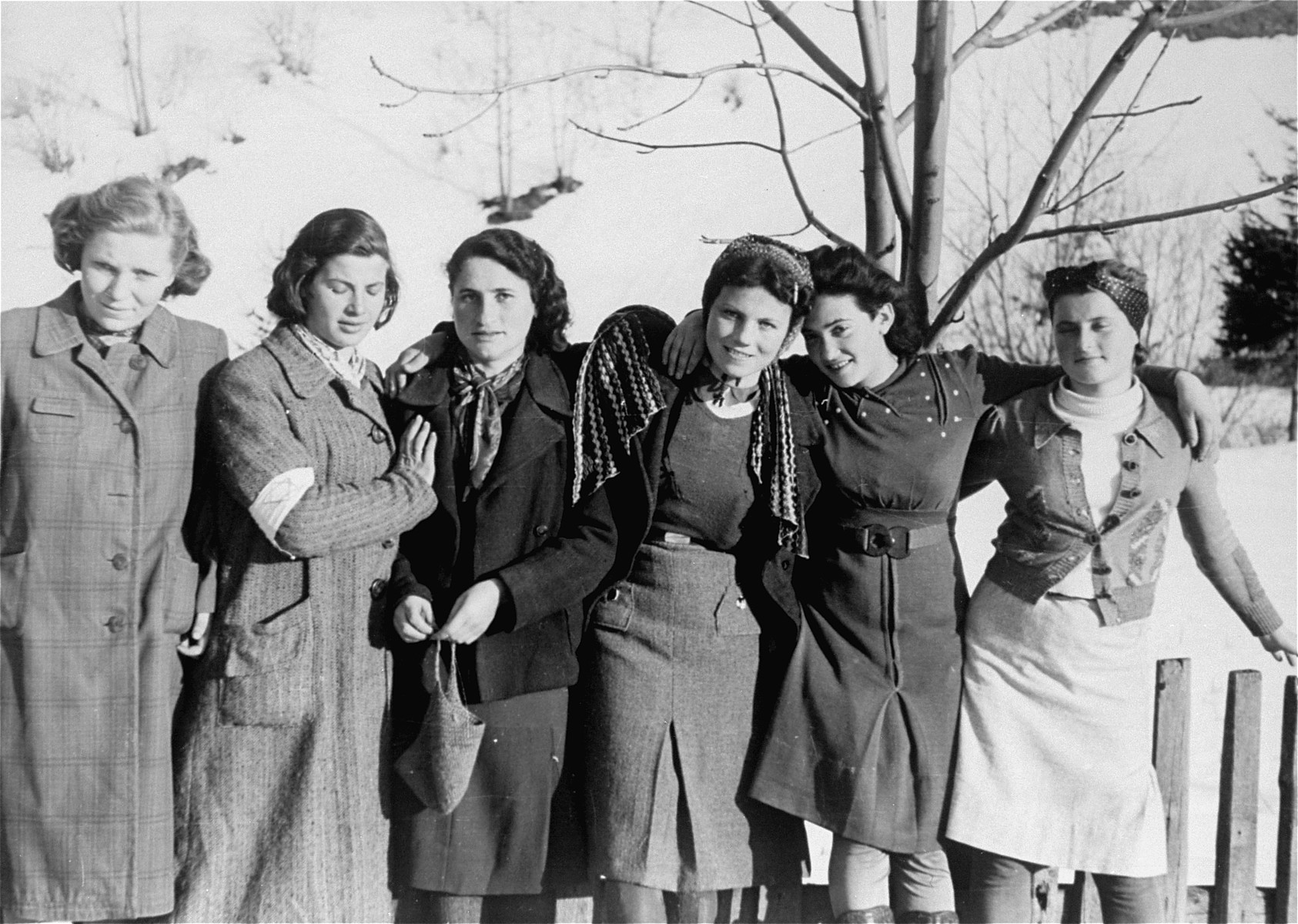 Local Jewish women, some wearing armbands, pose for a photo taken by Jewish conscripts in the Hungarian Labor Service.