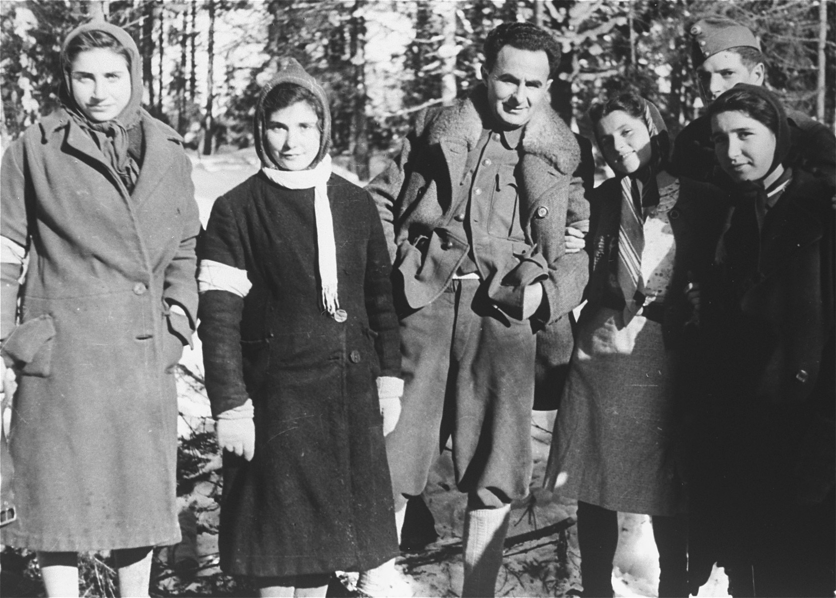 Local Jewish women wearing armbands pose with Jewish conscripts in the Hungarian Labor Service near the Hungarian-Jewish Labor Camp where Company 108/57 was housed.
