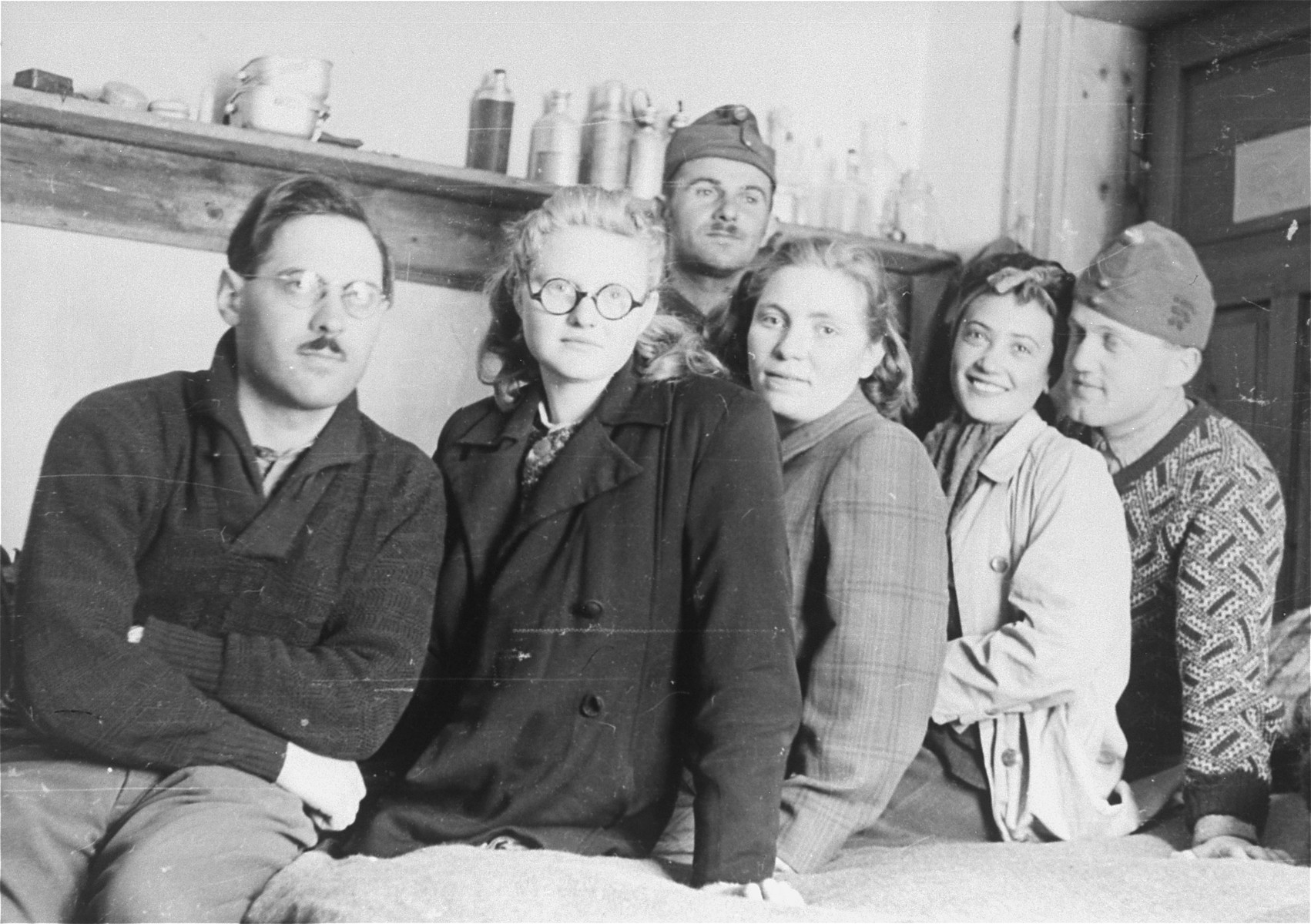 Local Jewish women pose for a photo with Dr. Adalbert Feher (L) and other Jewish conscripts in Company 108/57 of the Hungarian Labor Service.
