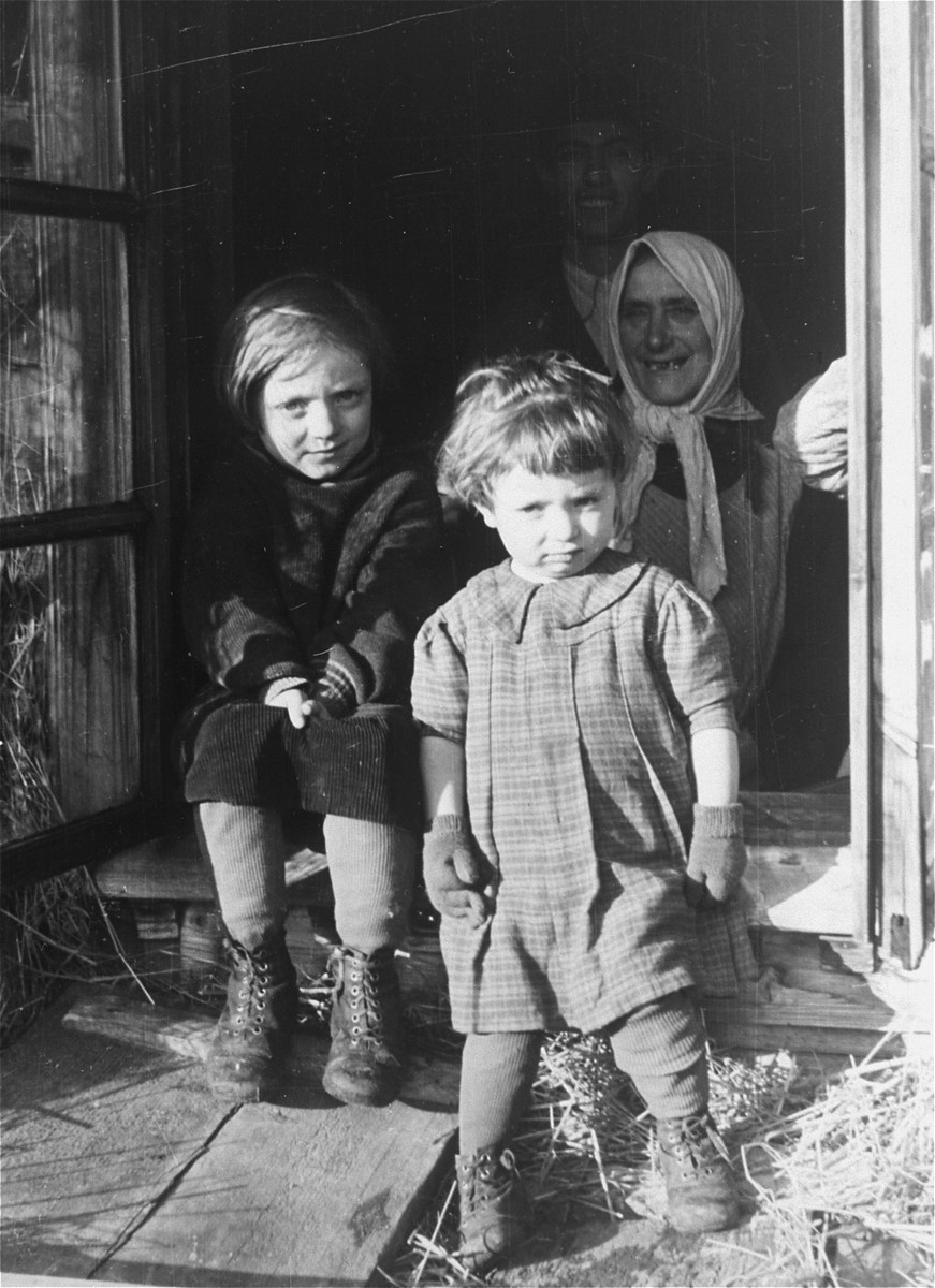 A Jewish family stands in the doorway of their home near the Hungarian-Jewish Labor Camp where Company 108/57 was housed.