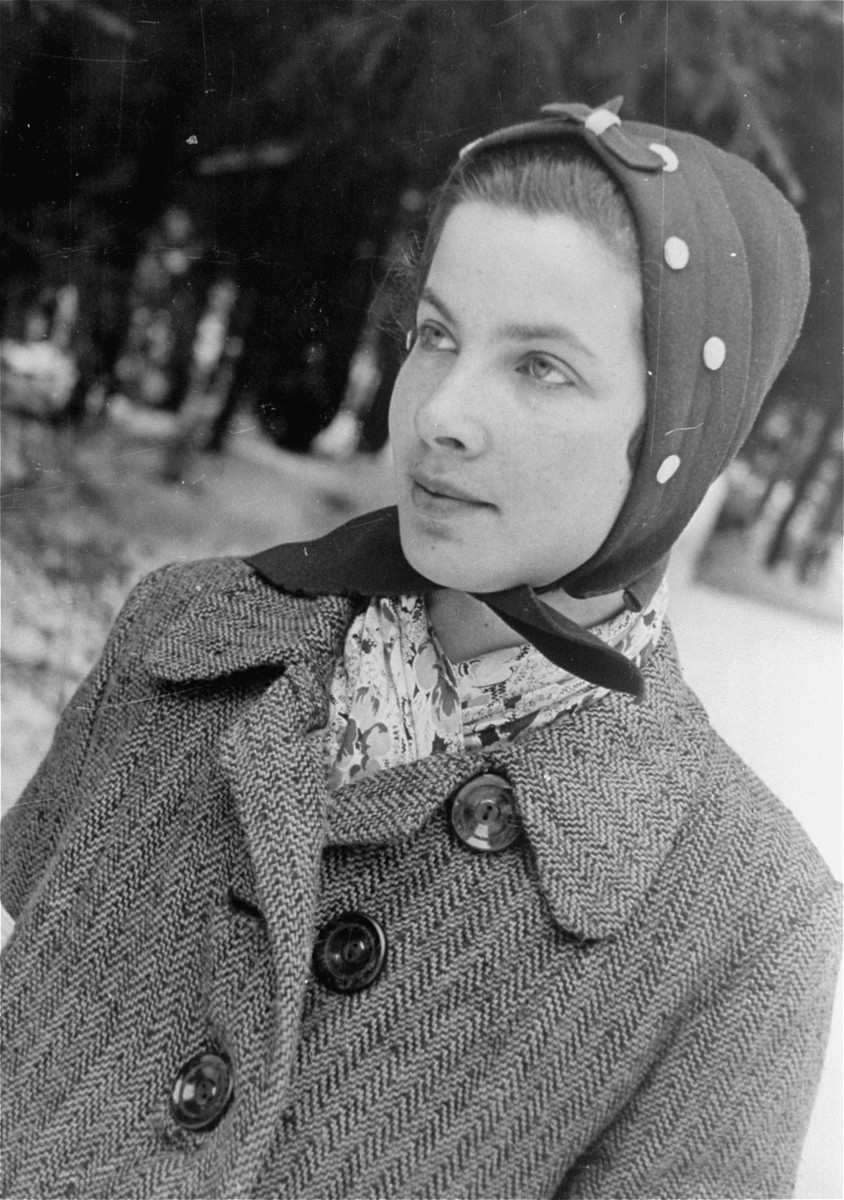 A local Jewish woman, wearing an armband, photographed by Jewish conscripts in the Hungarian Labor Service.
