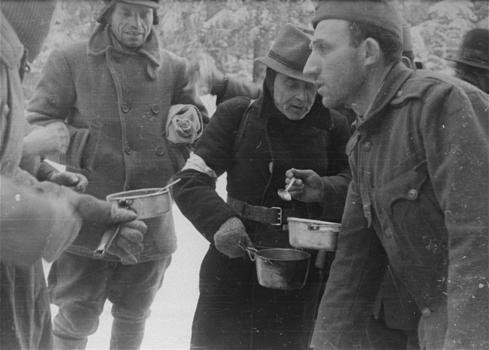 Jewish conscripts in Company 108/57 of the Hungarian Labor Service at mealtime.