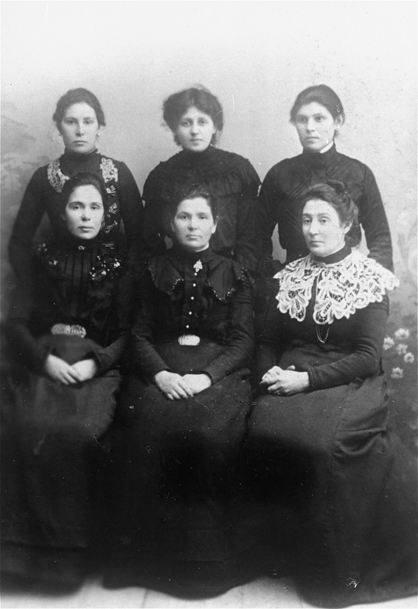 Studio portrait of six Jewish women in Vilna.  Pictured are Genya (Settel) Magid) and her five sister-in-laws.  In the back row, from left to right are: Rachel Ass, Genya (Settel) Magid, Tzvia Rudashevsky, Esther Eppel, Rivka Garber and Fanya Mikalavefskaya.