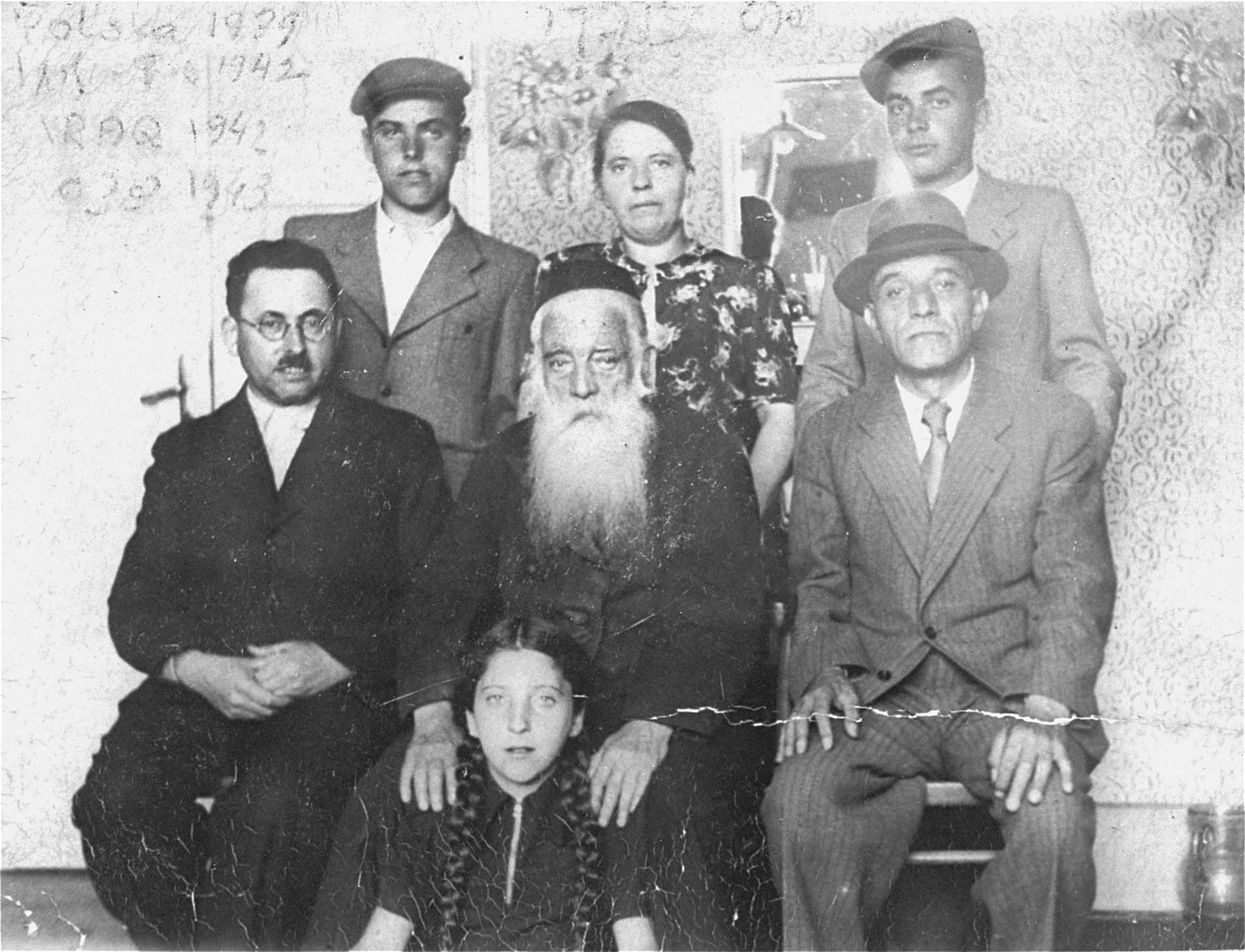 A family photograph taken on the occasion of Joshua Heilman, the donor, leaving for Palestine.    Standing, from the right:  Joshua; his mother, Rebecca; his brother, Zev.  Sitting, from the right are: Josef Rost, donor's maternal uncle; Noe Rost, a maternal grandfather, who was a government official responsible for registration of births, weddings and deaths in the Jewish community;  Shraga Faivel Heilman, donor's father and Roza Shoshana, donor's sister, sitting in front of her grandfather.  Joshua Heilman, also known as Oskar Henryk, left for Palestine on August 22, 1939.  He studied at the Hebrew University in Jerusalem and in 1942 enlisted in the British army.
