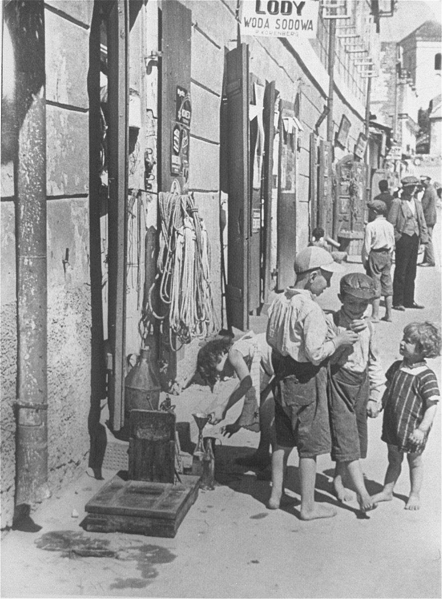 Jewish children sell soft drinks at the entrance to Mr. Korenberg's ice-cream shop.