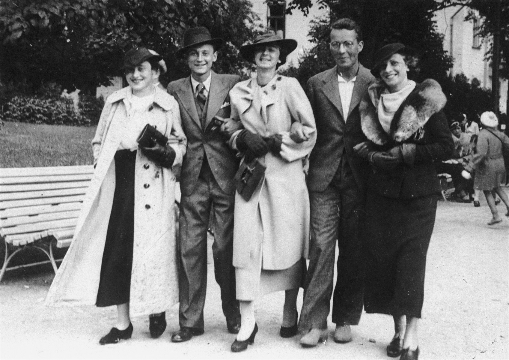 A group of Jewish friends stroll through the streets of Vilna.  Among those pictured are, Raya Magid (far right); Raya Lewin (far left).