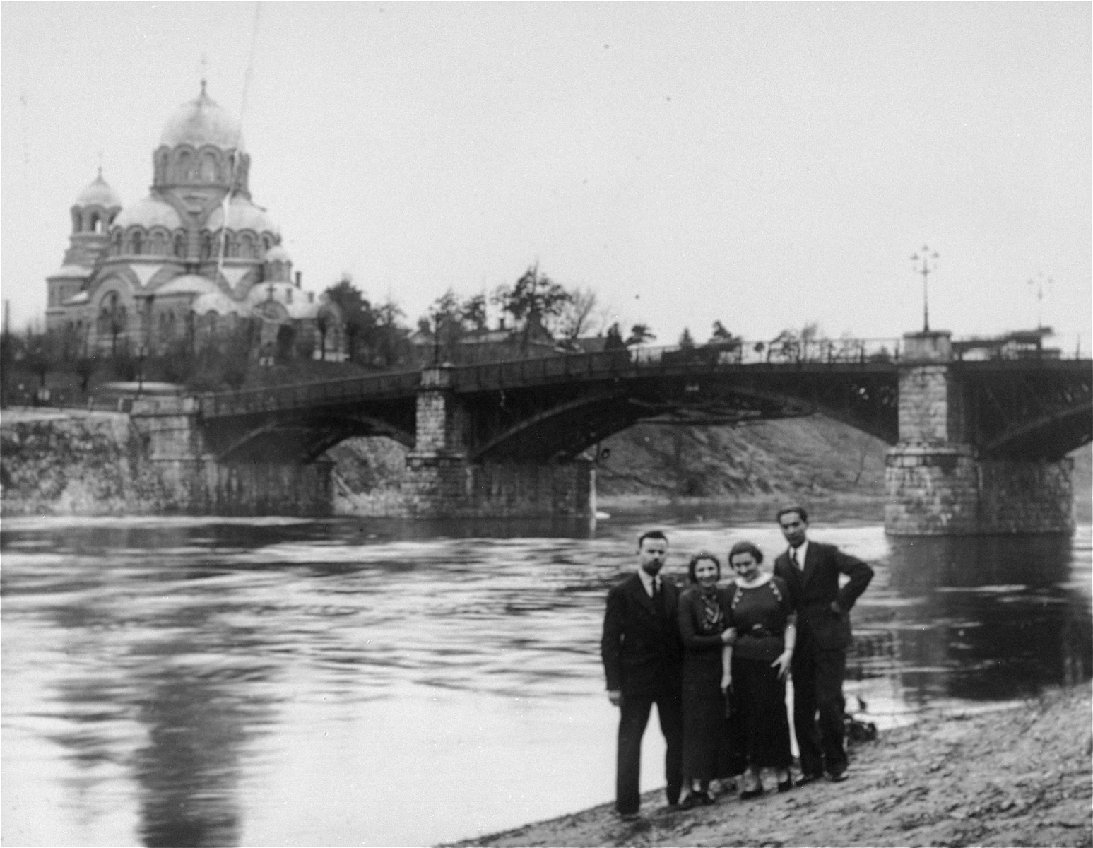 A group of Jewish friends pose beneath a bridge in Vilna.    Among those pictured are Raya Magid (right), and Raya Lewin.
