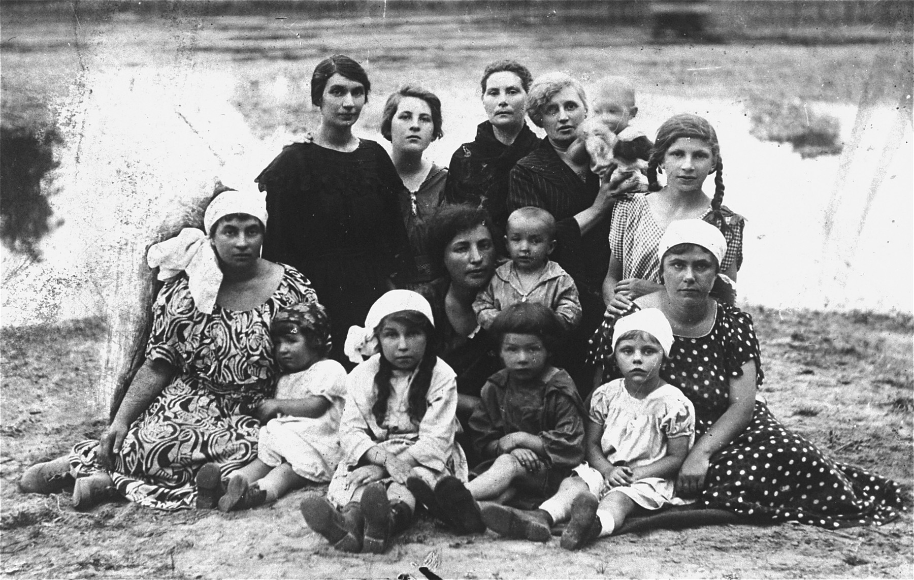 Group portrait of the Magid and Eppel families in the Vilna countryside.