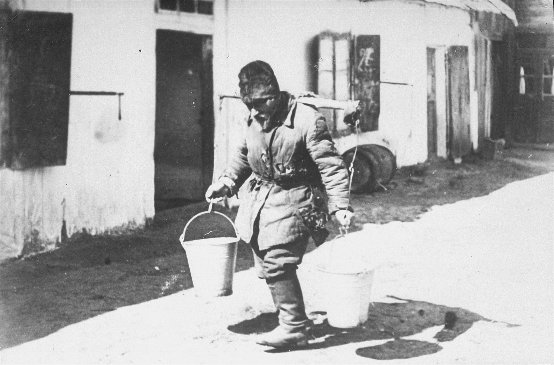 A blind water carrier delivers water to the wealthier Jewish families in town.