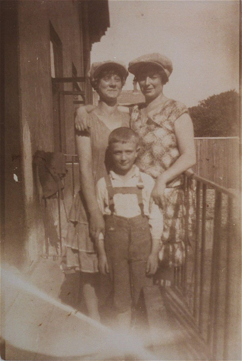 Group portrait of three Jewish cousins on a balcony in Jaroslaw, Poland.  Pictured are Chaja Ringelheim (left), her brother, Josef (front), and her cousin Mala Reich.  Chaja Ringelheim is the donor's aunt.
