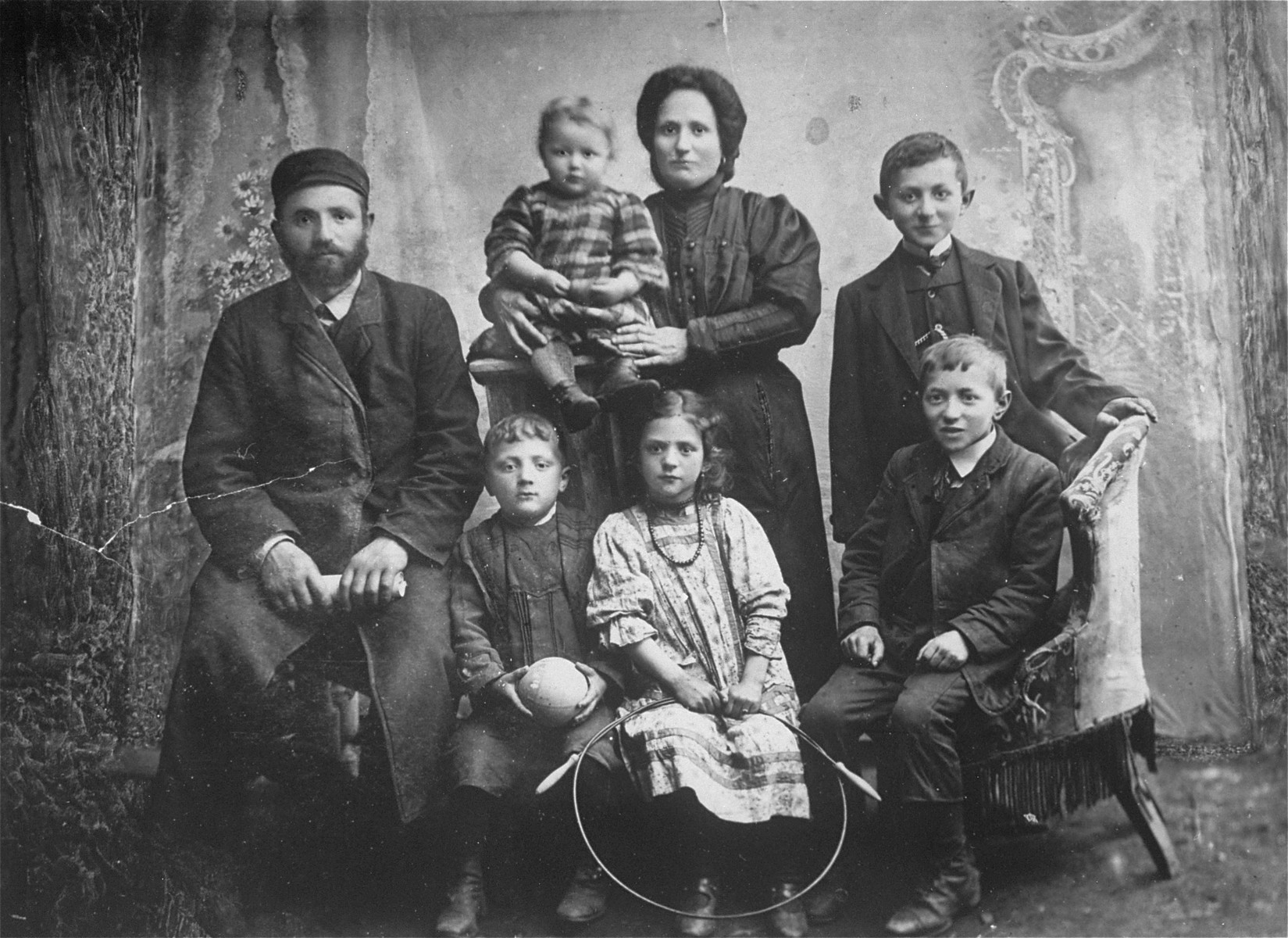 Family photograph of Samuel and Rachel Weiss and their five children: Sarah, Regina (donor's mother), Max, David and Adolph.  The Yiddish inscription on the back reads: To Elke Malche Weiss: Dear sister, I don't know where you are. Send me your address. Sent by your brother. Samuel Weiss died before the war, Rachel and Sarah perished in the Holocaust. Max, David and Adolph immigrated to the U.S via Argentine in the early 1940's. Regina survived Auschwitz and Dachau, came to the U.S after the war, where she met and married Jack Roth.