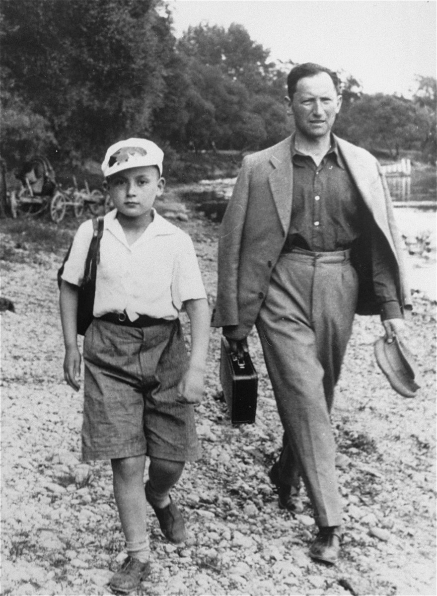 A Jewish father and son walking outside near a body of water in Vilna.  Pictured are Eli Rudashevsky and his son Yitzhak.