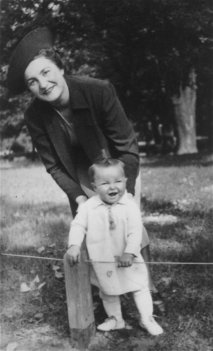 A young Jewish mother poses with her infant daughter in a park in Lvov.  Pictured are Laura Schwarzwald and her daughter Selma.