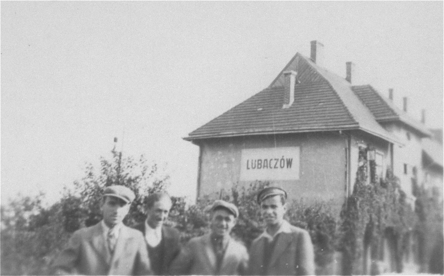 Joshua Heilman with three friends at the railroad station in Lubaczow.