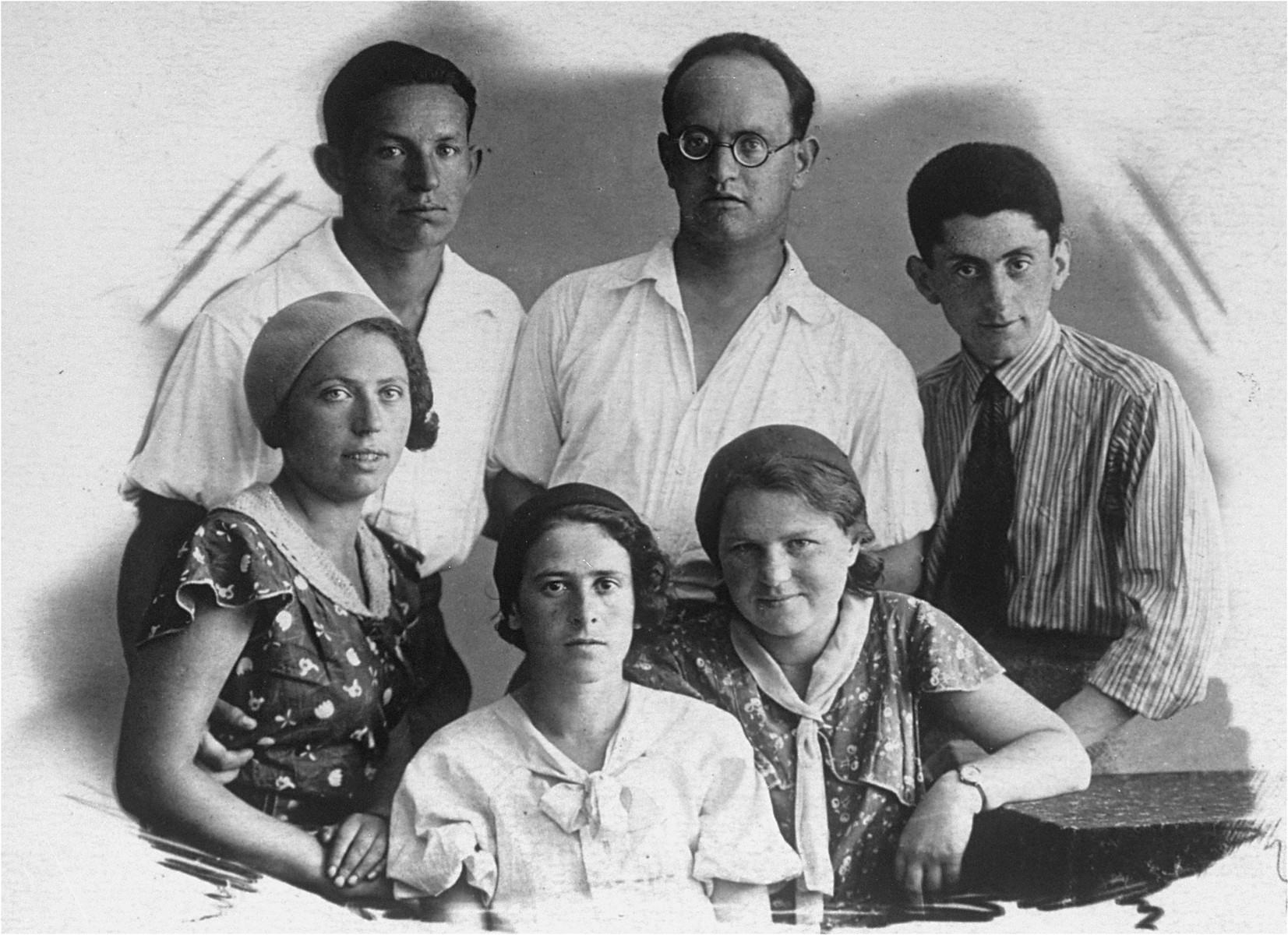 Studio portrait of members of the Rudashevsky family in Vilna.   Pictured in the back row from left to right are: Shika Jurer, Avraham Jurer and Mula Mirsky.  In the front row from left to right are: Hannah Jurer, Rosa Rudashevsky, and Sarah Rudashevsky.