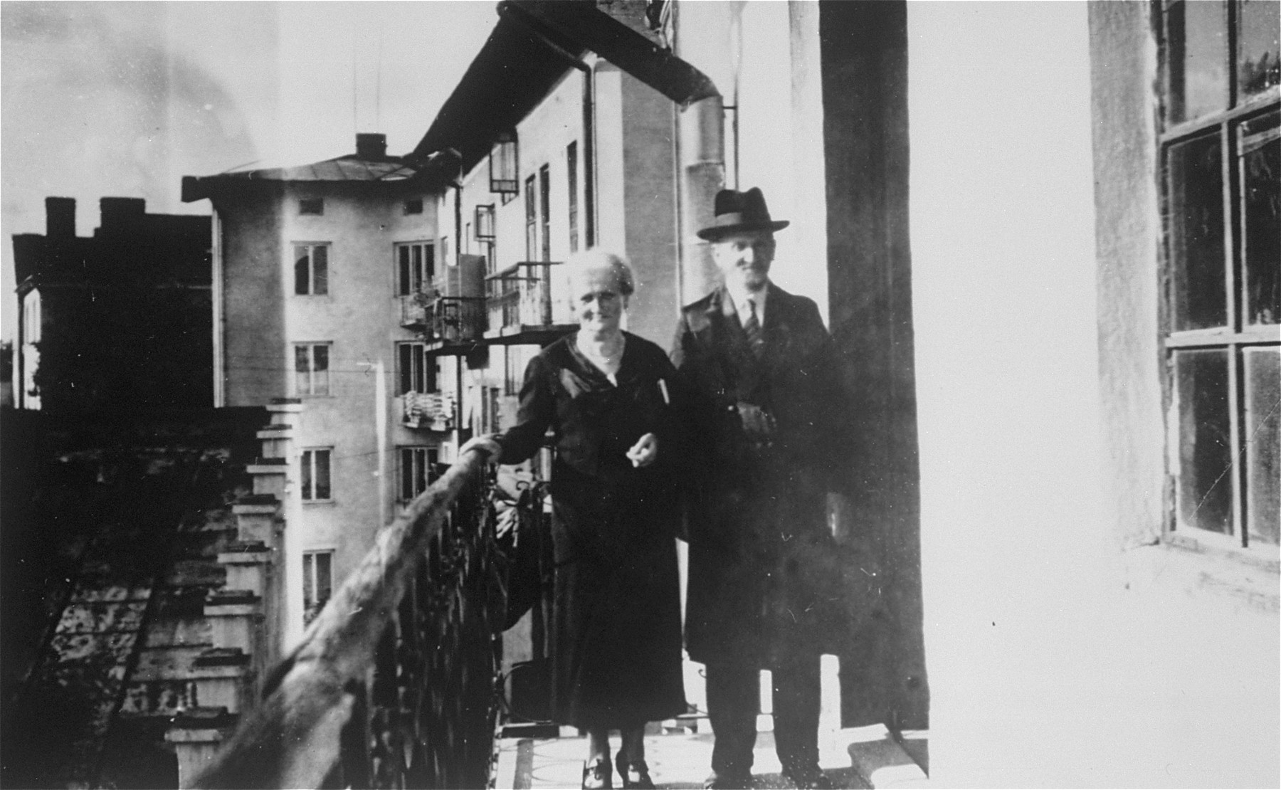 An elderly Jewish couple poses on the balcony of their home in Przemysl, Poland.  Pictured are Jacob and Miriam (Reich) Ringelheim, the donor's grandparents.