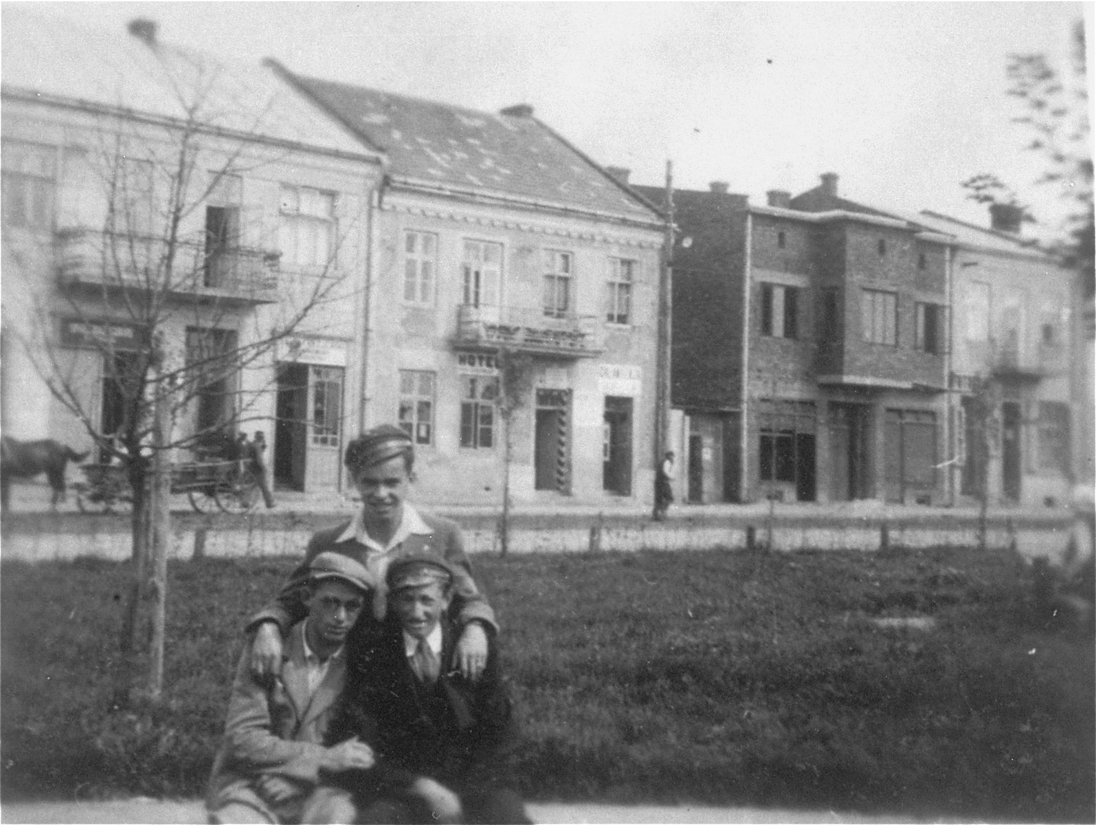 Joshua Heilman with two friends in the center of Lubaczow.