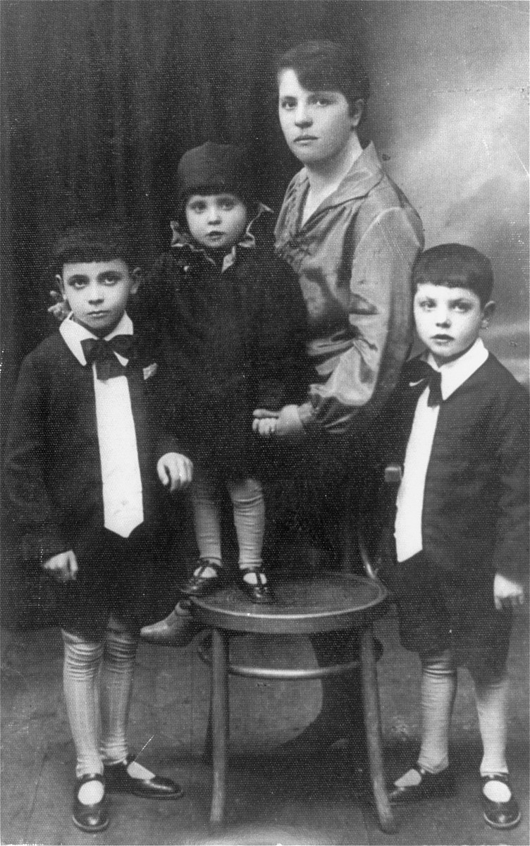 Helena Ita Rost Heilman, donor's mother with her three children.    Standing on the left is Joshua (9 years old), the donor,  his sister, Shoshana (4 years old) and his brother, Zev (8 yaers old).    Shoshana survived Auschwitz concentration camp.  Zev was murdered in the Belzec death camp.