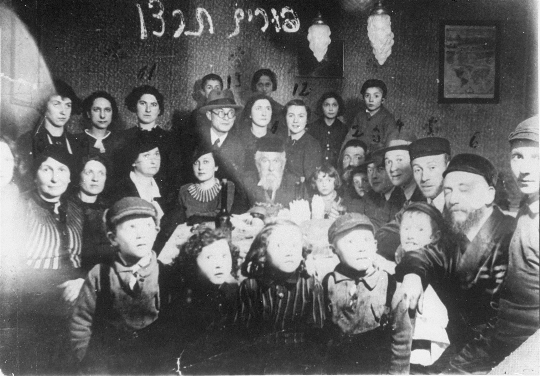 Members of the extended Rosental Vigotska family attend a family celebration on Purim.   Among those pictured are Yona Wygocka Dickmann and Hajr Naselewicz Chume, two of the three members of the extended family who survived the war.
