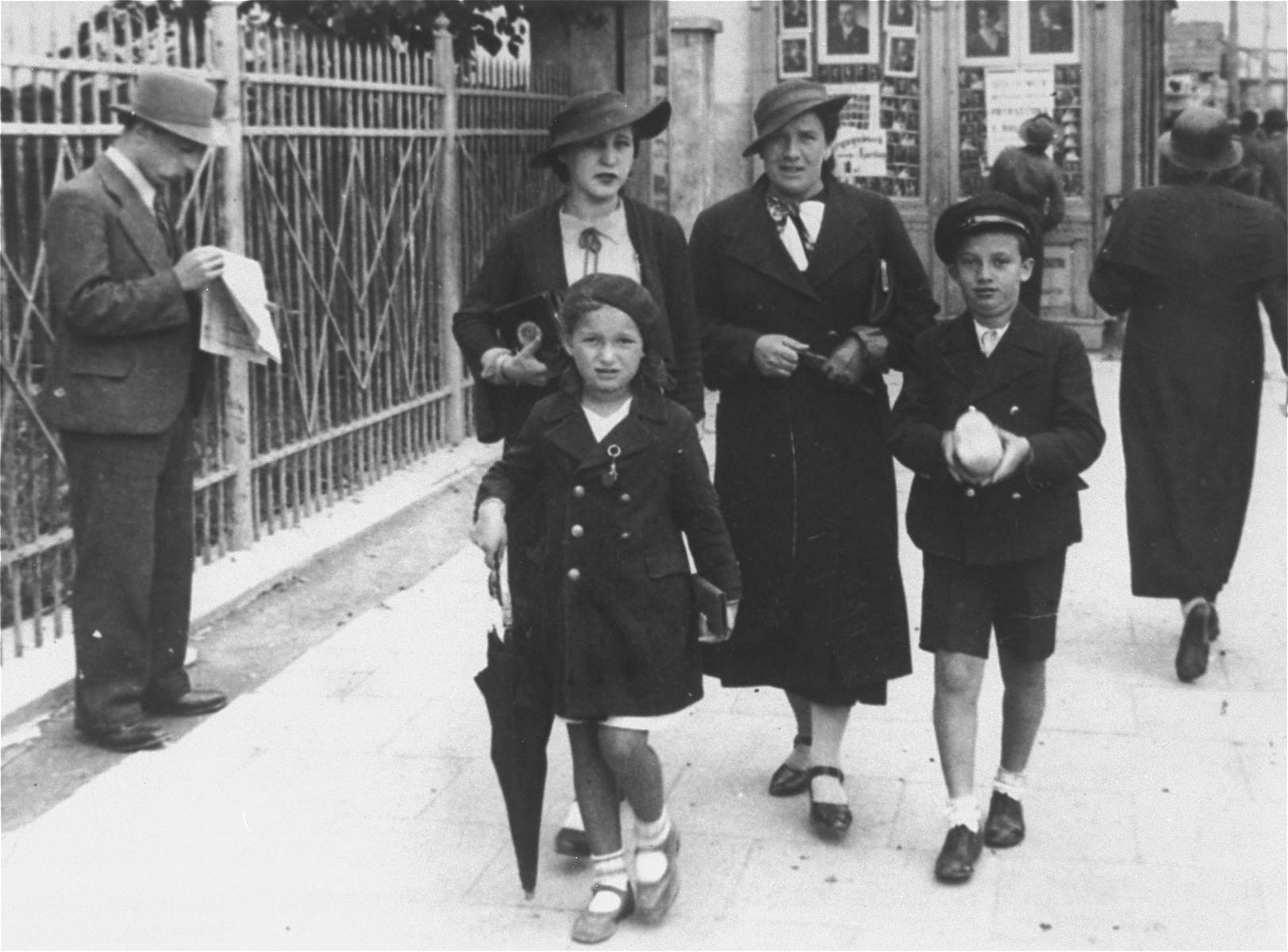Sabina, her brother Jurek and  mother Sala Haberman (nee Kulewicz) walk down the main street of Borislav on Ulica Panska.   Her mother's friend Herzfeld (on the left) accompanies them.