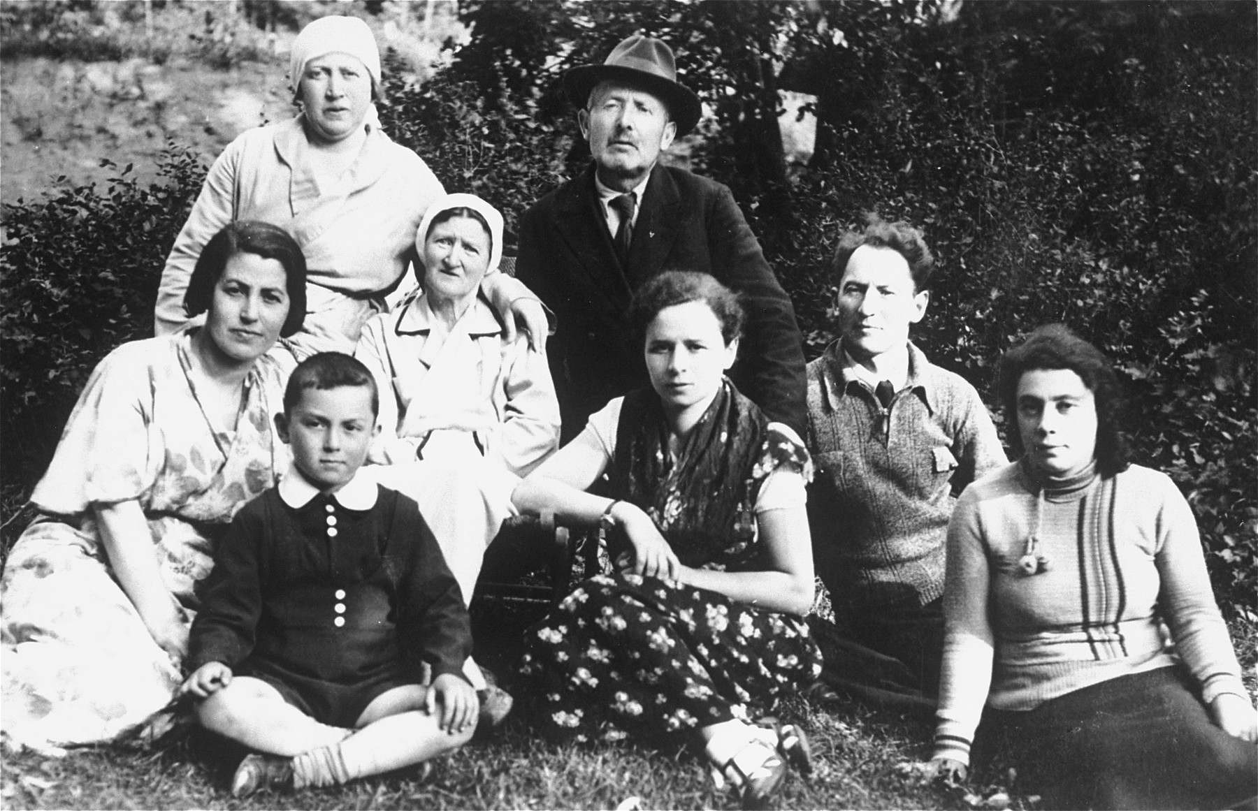 Group portrait of members of the extended Rudashevsky family in Vilna.   Among those pictured are Yitzhak Rudashevsky (front row left), his mother Rosa (second row, left, behind Yitzhak), his father Eli (second from the right), his cousin Yona Rudashevsky (front row, center), his uncle Zvi Yaakov Rudashevsky (back row wearing the hat).