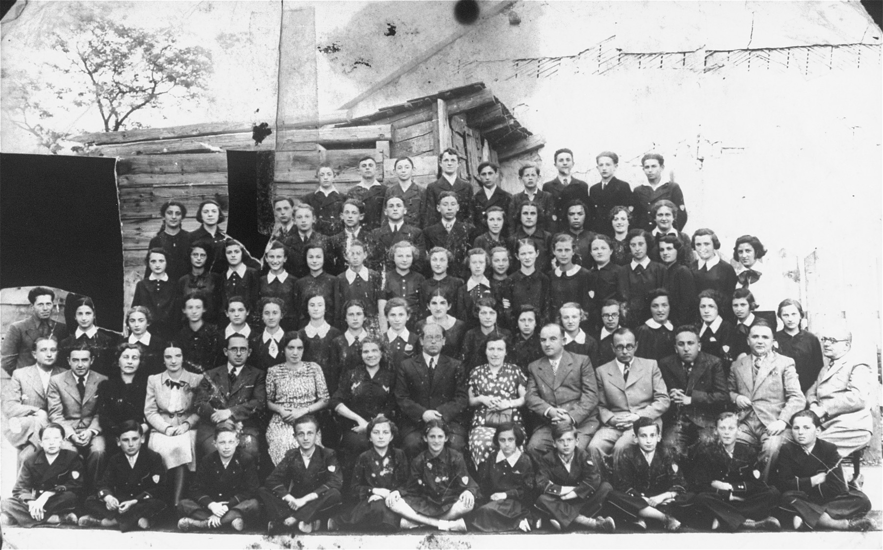 Group portrait of the faculty and students of the Hebrew gymnasium in Czortkow.  Bronia Wasserman is on the far left of the fifth row.  Her sister Zosia Wasserman is in the third row, 11th from the left.