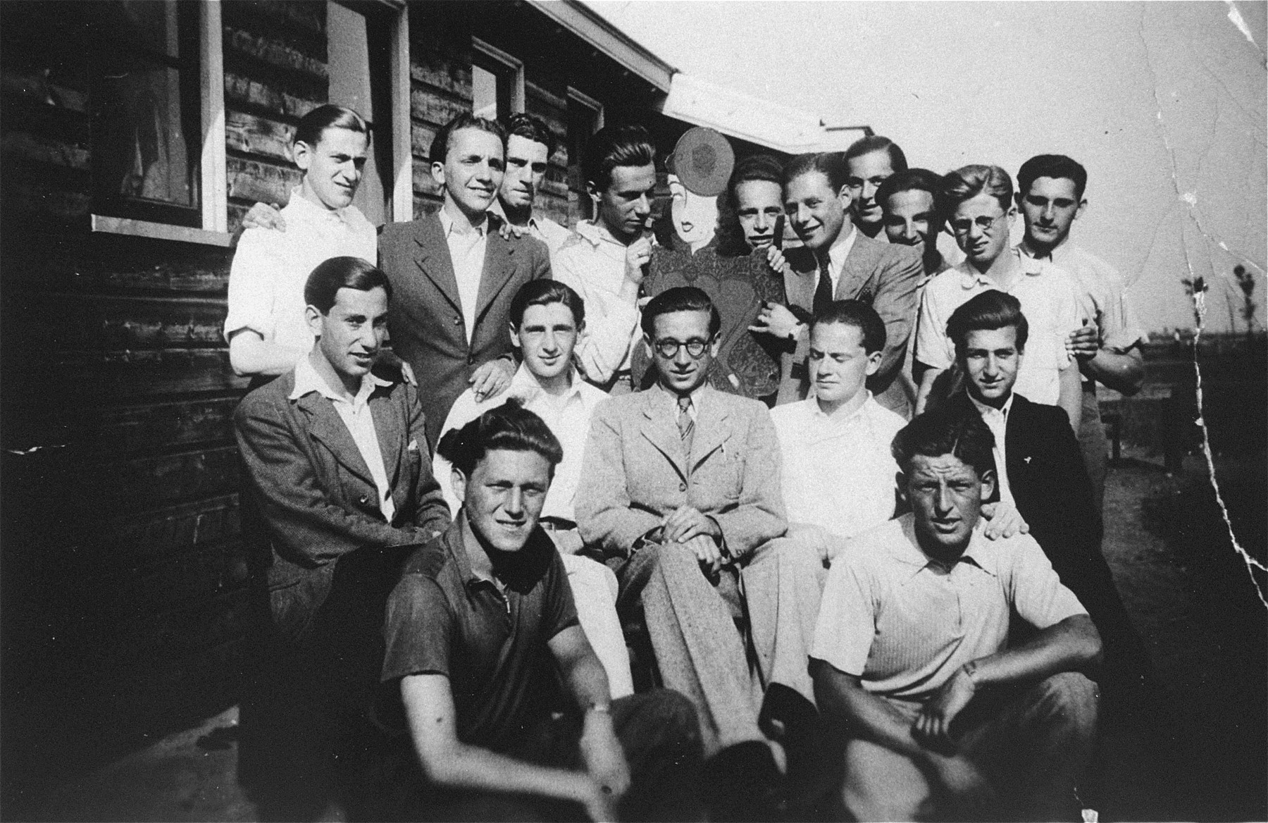 Group portrait of German Jews living in barracks no.6 in the Westerbork camp during the period when it was still a camp for illegal Jewish refugees in Holland.    Among those pictured are (front row, left to right):  Werner Berger and Fritz Straus; (middle row, left to right):  Werner Katz, Guenter Frage, Rolf Levy, Kurt Hirschfeld, and Erwin Panthauer; (top row, left to right) Bernt Stein, Abramowitz, unknown, unknown, Fritz Schwarz, Manfred Schwartz, Werner Roman, Bernard Koebner, Siebert Fischer, unknown, Gert Zilenzinger, Siegbert Fisher, Guenther Rotchen.