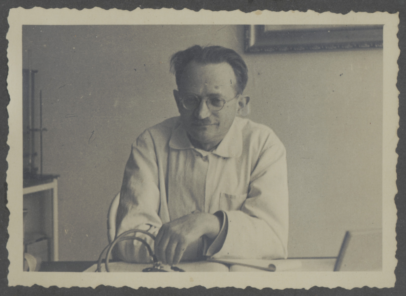 Close-up portrait of a Jewish physician in his office in Bielsko Biala.  Pictured is Dr. Adzio Zeilender, the uncle of the donor.  He and his family perished in the Holocaust.