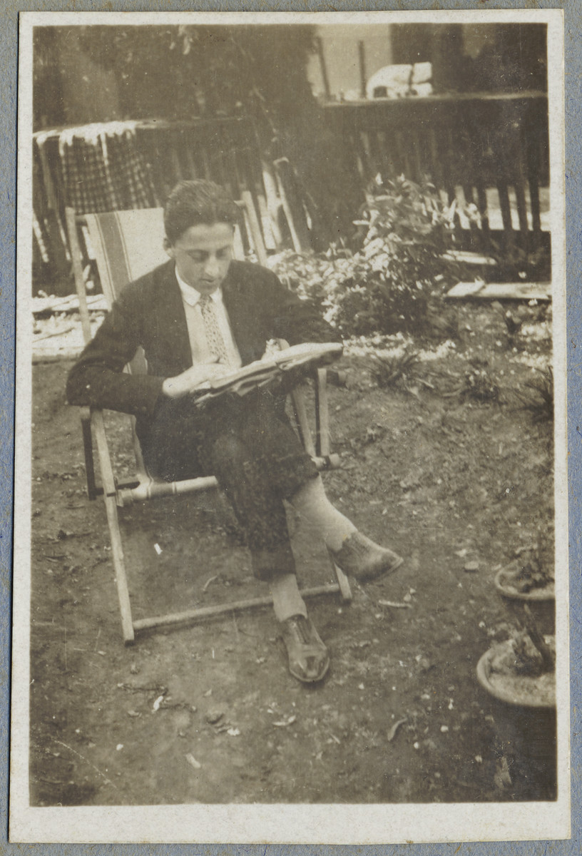 Istvan (Stefan) Richter sits outside his home in Berehovo and reads a book.